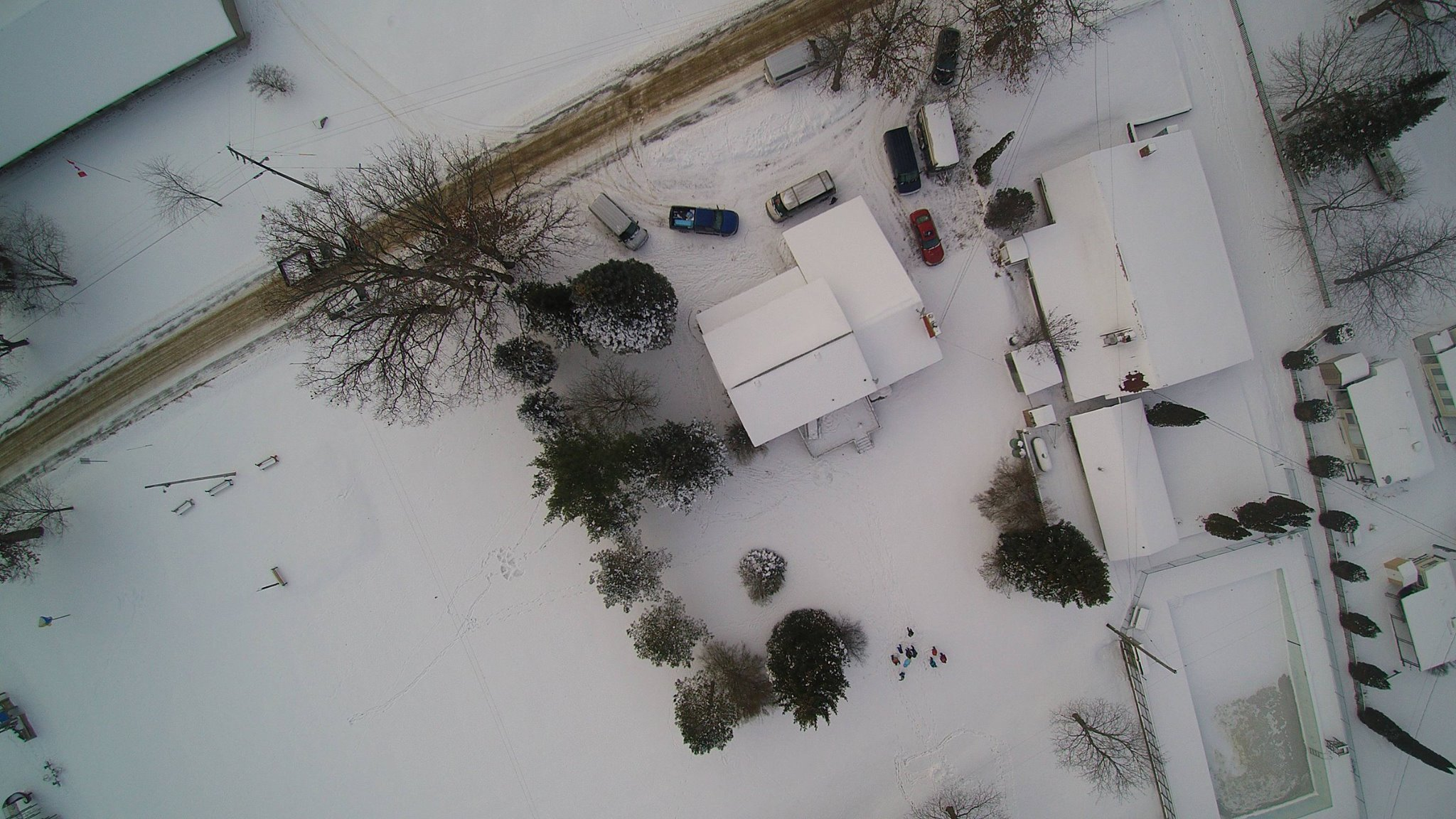 A friend brought his drone to our Christmas party and took this picture of the house we are staying in.  You can see the park's snack shop to the right of the house, the pool, and even a couple of the trailers.  Pretty neat, eh?