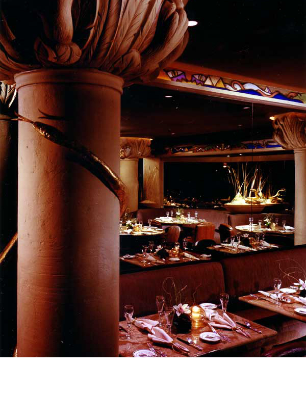 Capitals designed as large cat paws with sand filled bowls of gold leafed cobras accent this desert inspired room.