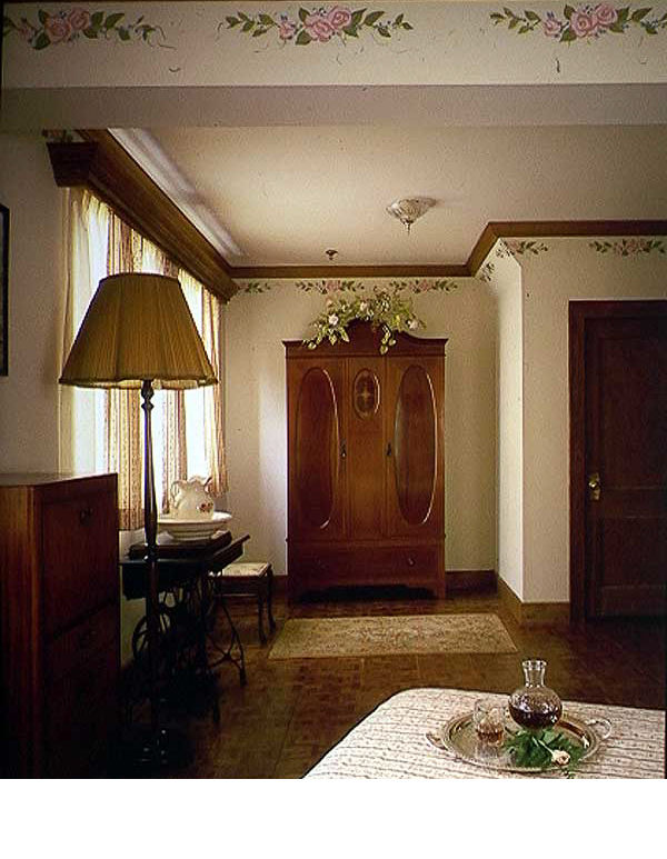 Low budget rooms were achieved by using found furniture in thrift stores and artwork painted on walls.