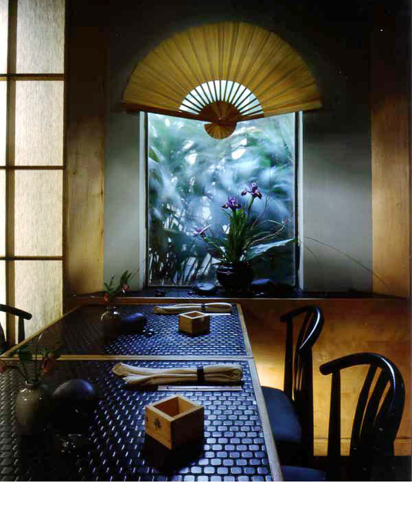 Backlit shoji screen separate seating areas. Arched windows allow natural light to illuminate fans.