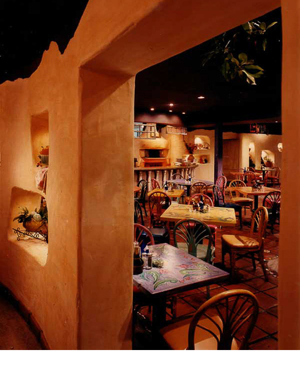Rattan chairs from a previous restaurant were glazed with various colors and added to handprainted tables.