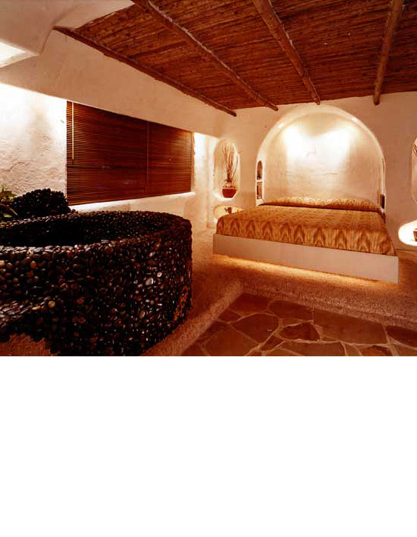 Aspen poles were used on the ceiling embedded in plaster. The tub was made with flat river rocks.