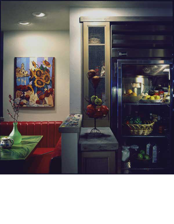 Industrial equipment was chosen to contrast the earthiness of the country style cabinets and counters.