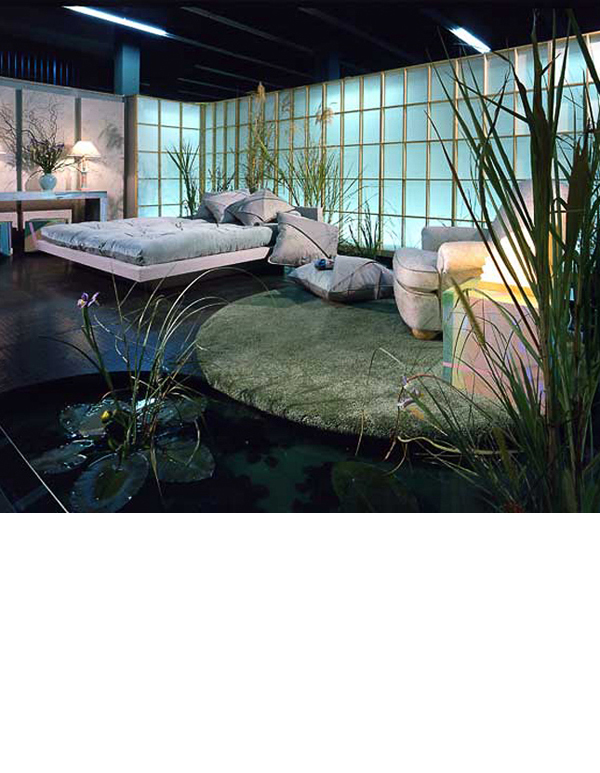 Water mote runs in front of shoji screens under the bed. Splatter painted canvas panels and upholstery is used throughout. Rubber flooring and carpeted 'lily pad' floor, offer contrasts of soft greens.