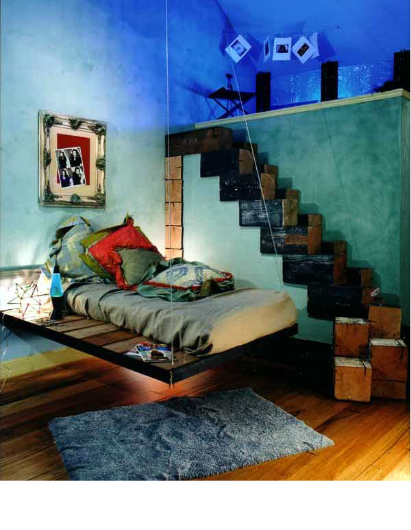 The entire room was made with found materials from the SF Dump. The glass panels in loft were made by an artist in residence there. Floating bed from scrap iron. Ten by ten beams used as risers.