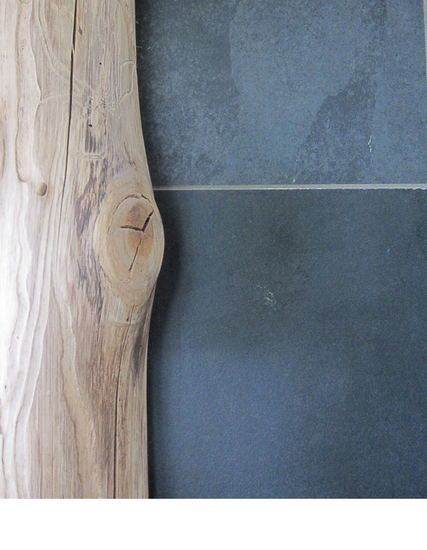 Slate was scribed carefully to fit the organic edge of the tree trunks.