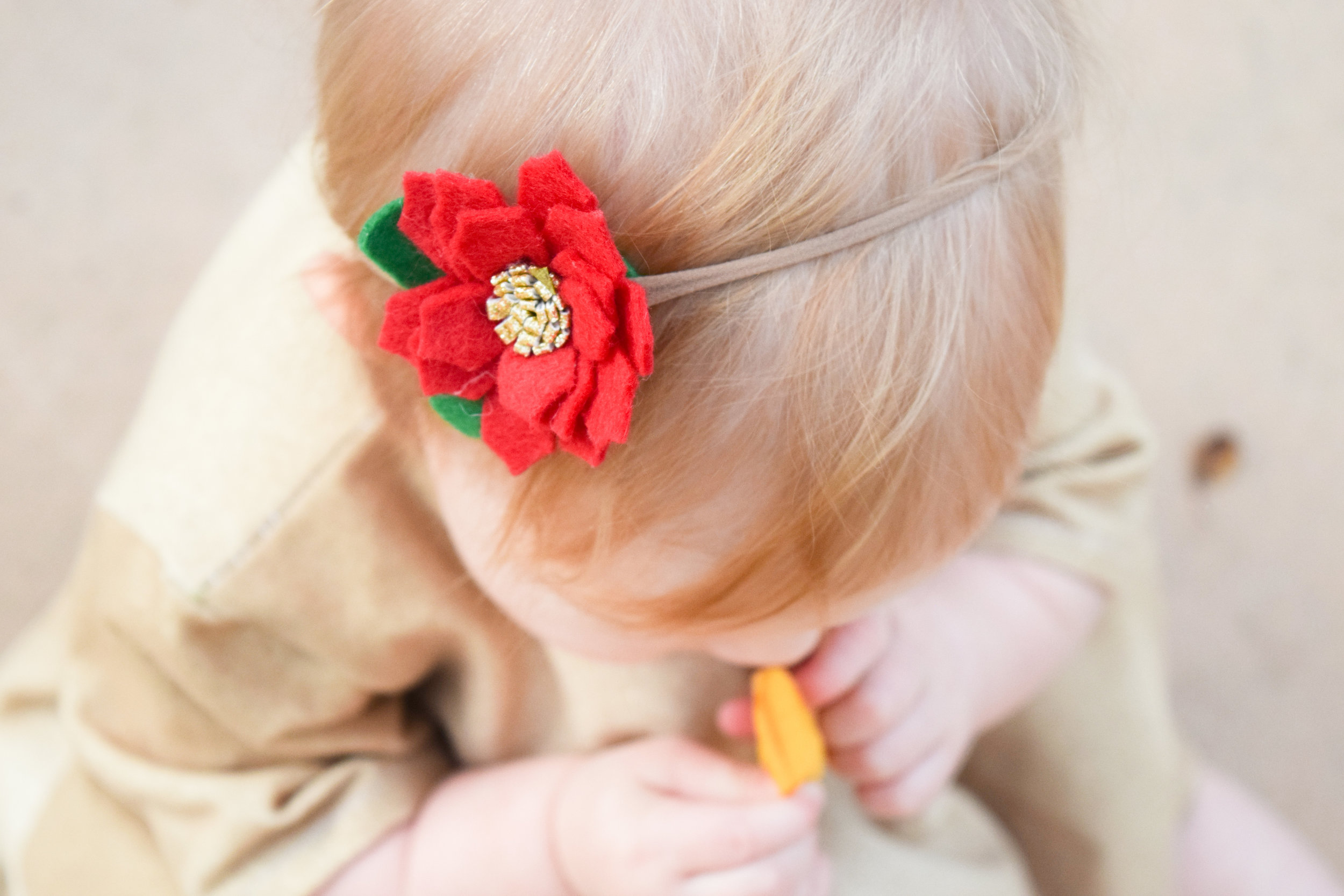 BABY FASHION | A gold baby holiday dress and red baby flower headband