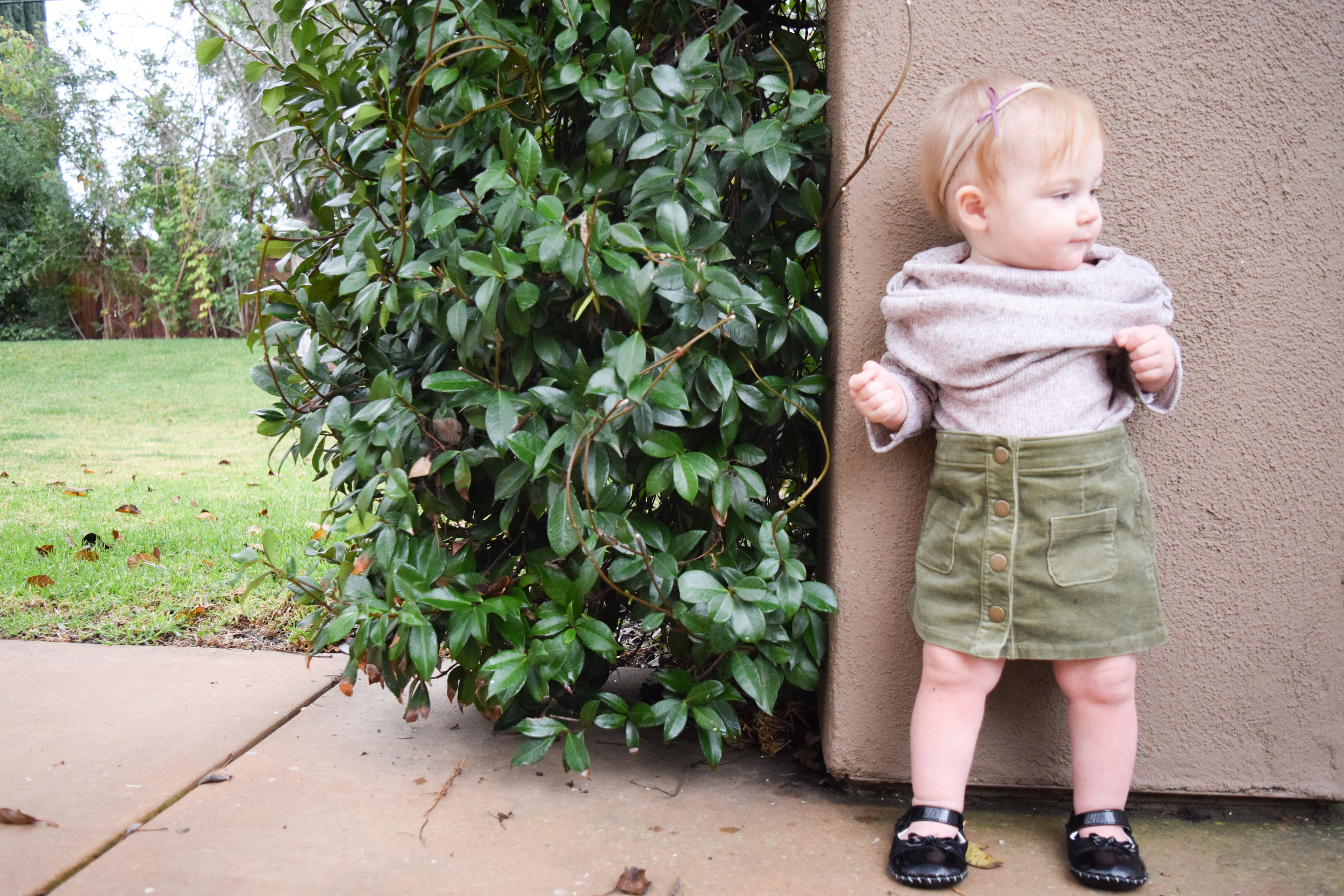 http://www.theoverwhelmedmommy.com/blog/baby-fashion-tan-off-the-shoulder-baby-tunic-olive-green-corduroy-baby-skirt