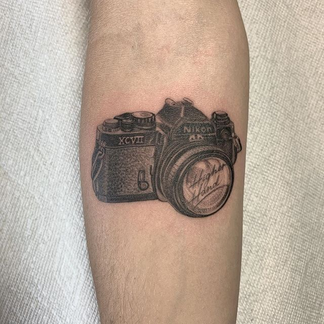 Nikon for @higherhand done at #bodyelectrictattoo . . . #tattoo #tattooing #la #losangeles #losangelestattoo #latattoo #melrose #rayjtattoo #smalltattoos #stippling #fineline #realism #nikon