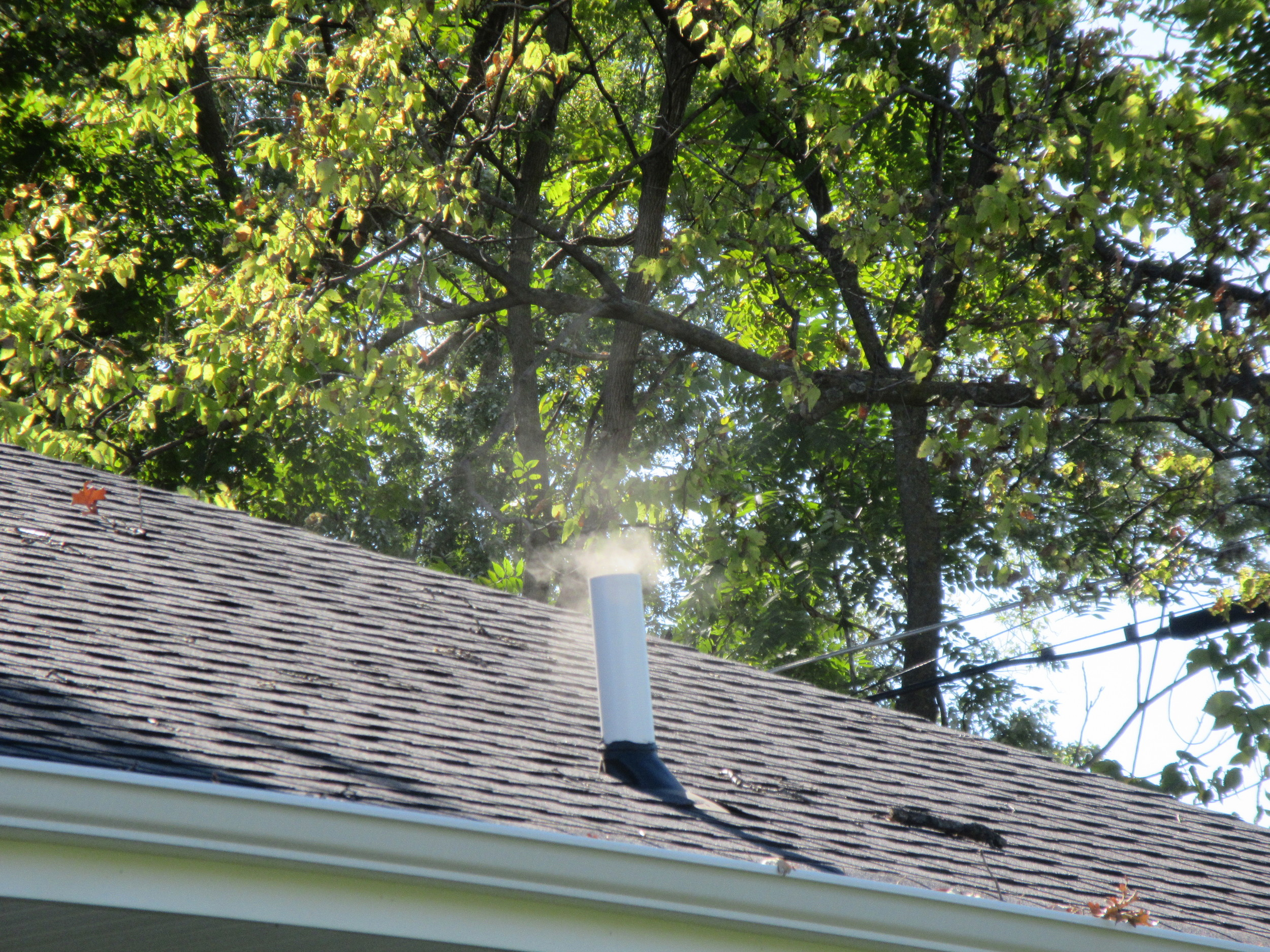Typical house vent stack smoking as a result of the testing.