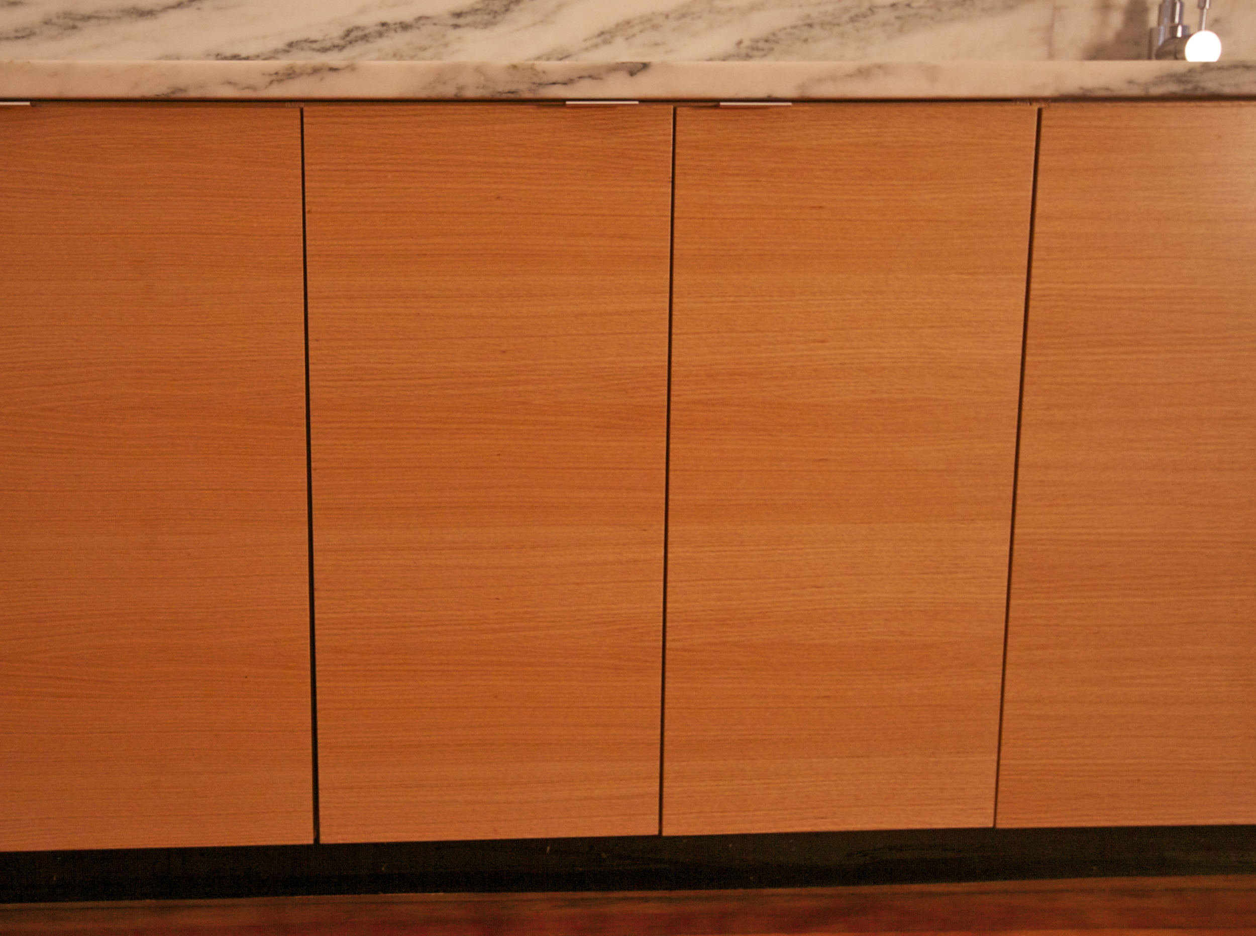 rift-sawn oak cabinets with marble counter