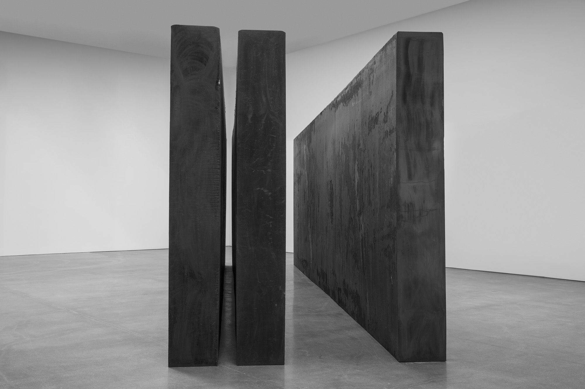 "RICHARD SERRA Through, 2015 Forged steel Three slabs, each: 9' 2"" x 29' 6"" x 16"" (2.8 m x 9 m x 40.6 cm) Overall: 9' 2"" x 29' 6"" x 92"" (2.8 m x 9 m x 234.3 cm) © Richard Serra. Photograph by Cristiano Mascaro."