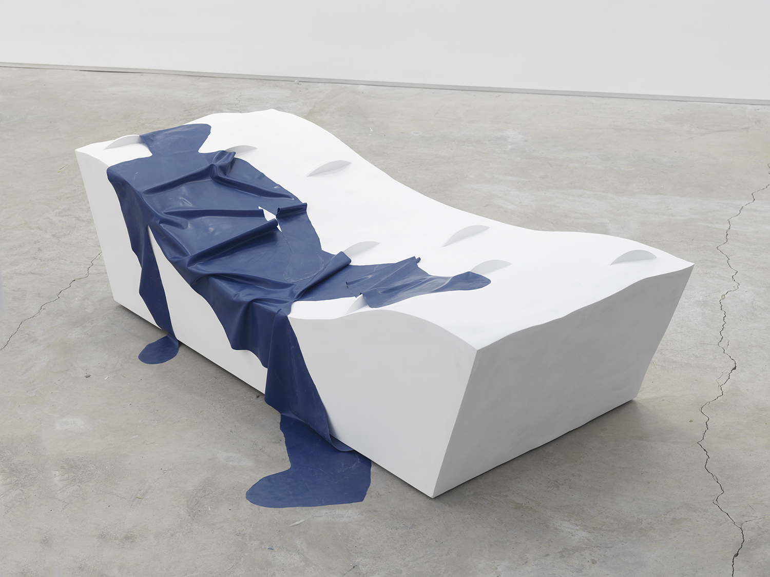 32H – EXISTENCE Passing through, being marked and to some extent damaged by the geography of the present. 2016, plaster, foam, wood and latex, 21 x 73 x 30 inches