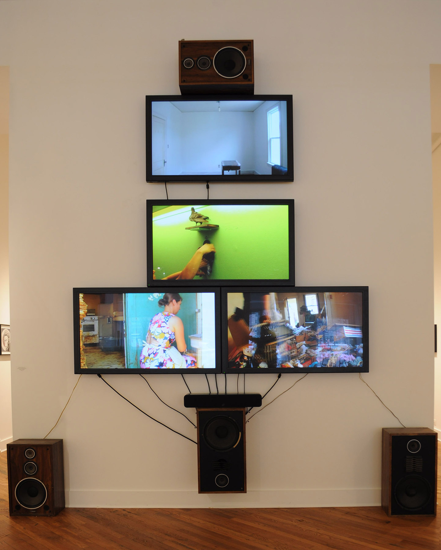 Ushers of the Accumulated 2017 , HD video with sound, plasma monitors, speakers, wires, cables, media players. 154 x 124 x 12 inches Unique