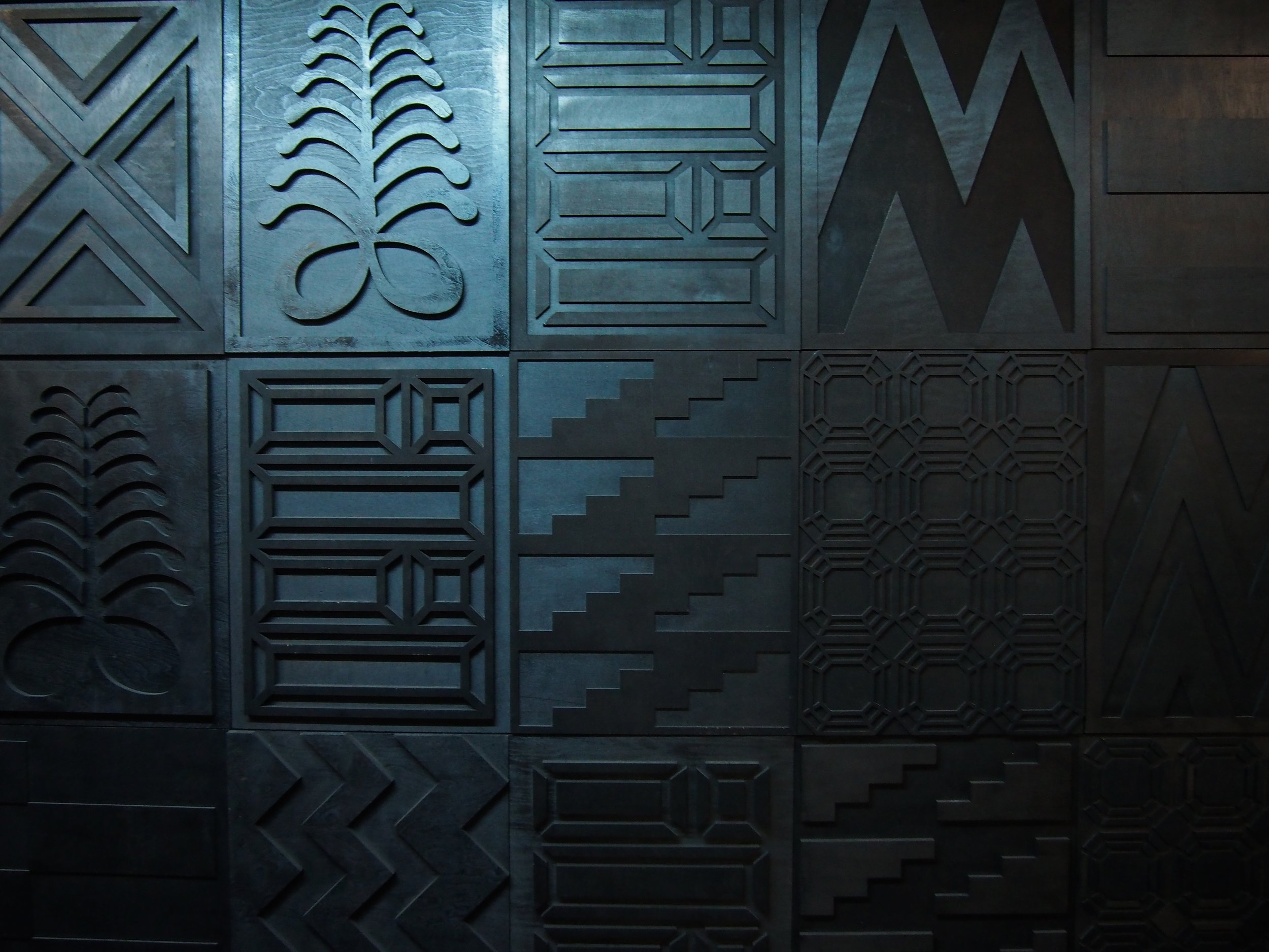 """Tiff Massey, Detail:  Noir Quilt Code 2 , 180"""" x 72"""" (variable), wood, 2015. Image Courtesy of the artist."""