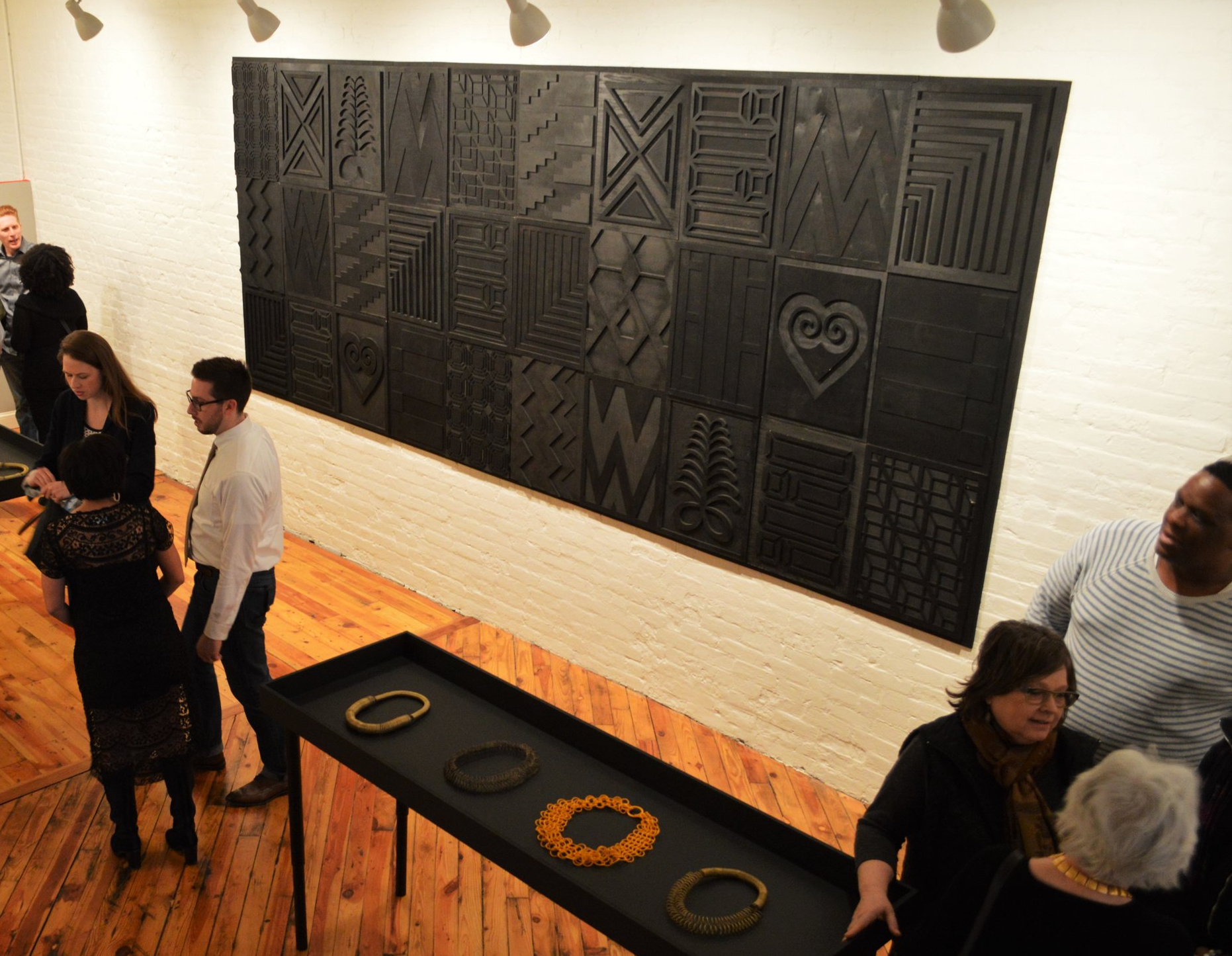 """Tiff Massey, Installation view:  Noir Quilt Code 2 , 180"""" x 72"""" (variable), wood, 2015. Image Courtesy of the artist."""