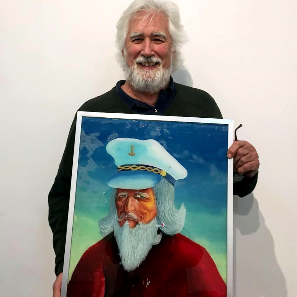 Jack Hanley at 30th anniversary gallery event holding present from  Maurizio Cattelan , 2017.