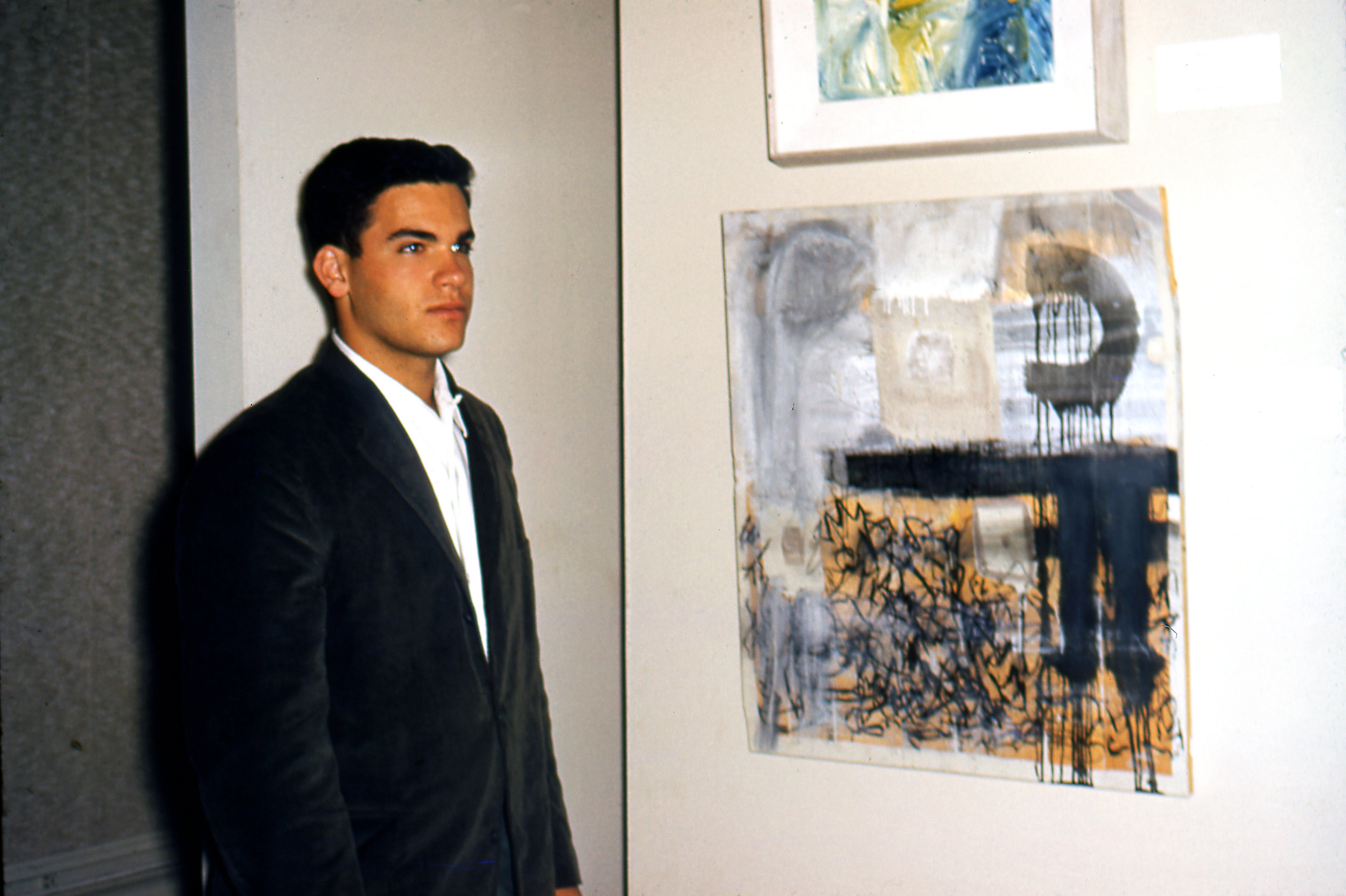Tony Berlant with his first painting,  Encounter Number 36 , at LACMA's annual Artists of Los Angeles County and Vicinity competition - 1960. Painting selected by critic Clement Greenberg.