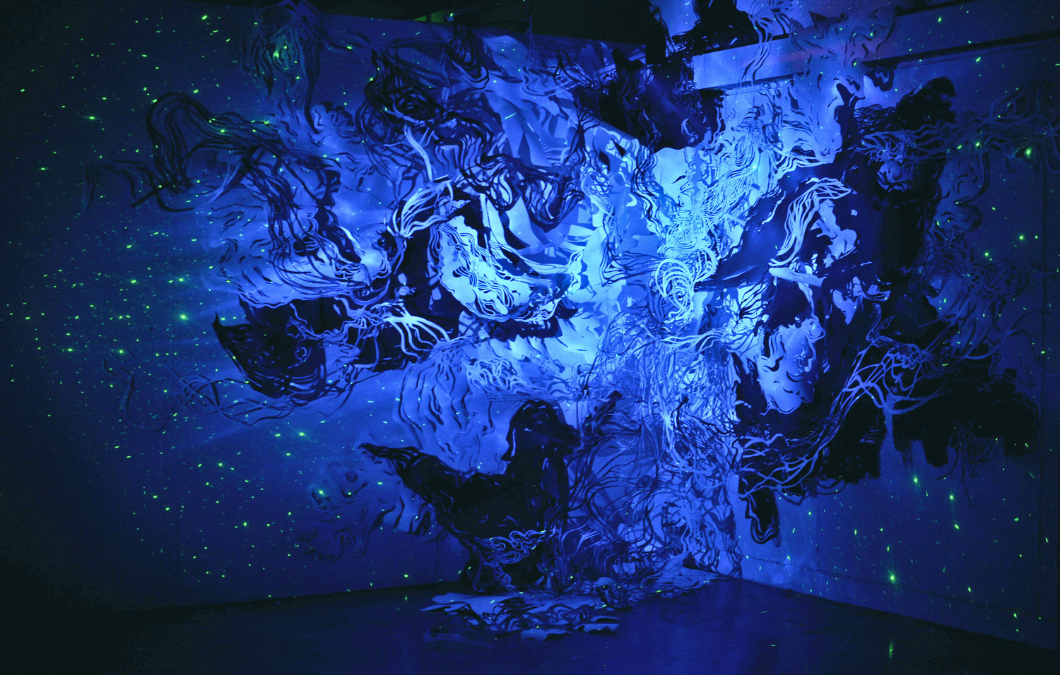 Projectile Heaven, 2012/13, hand-cut paper, sumi ink, light projections, approximately 10'x10'x10'