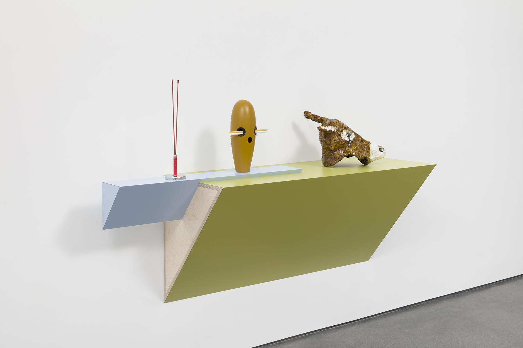 "closed at sunset except for fishing , 2019, Plastic laminated wood shelf, CB radio antenna, plastic Latin Percussion ""Super G¸iroî, plastic G¸iro scrapers, ceramic donkey head, 43 5/8 x 71 x 21 inches (110.8 x 180.3 x 53.3 cm). Courtesy of the artist and Tanya Bonakdar Gallery, New York / Los Angeles"