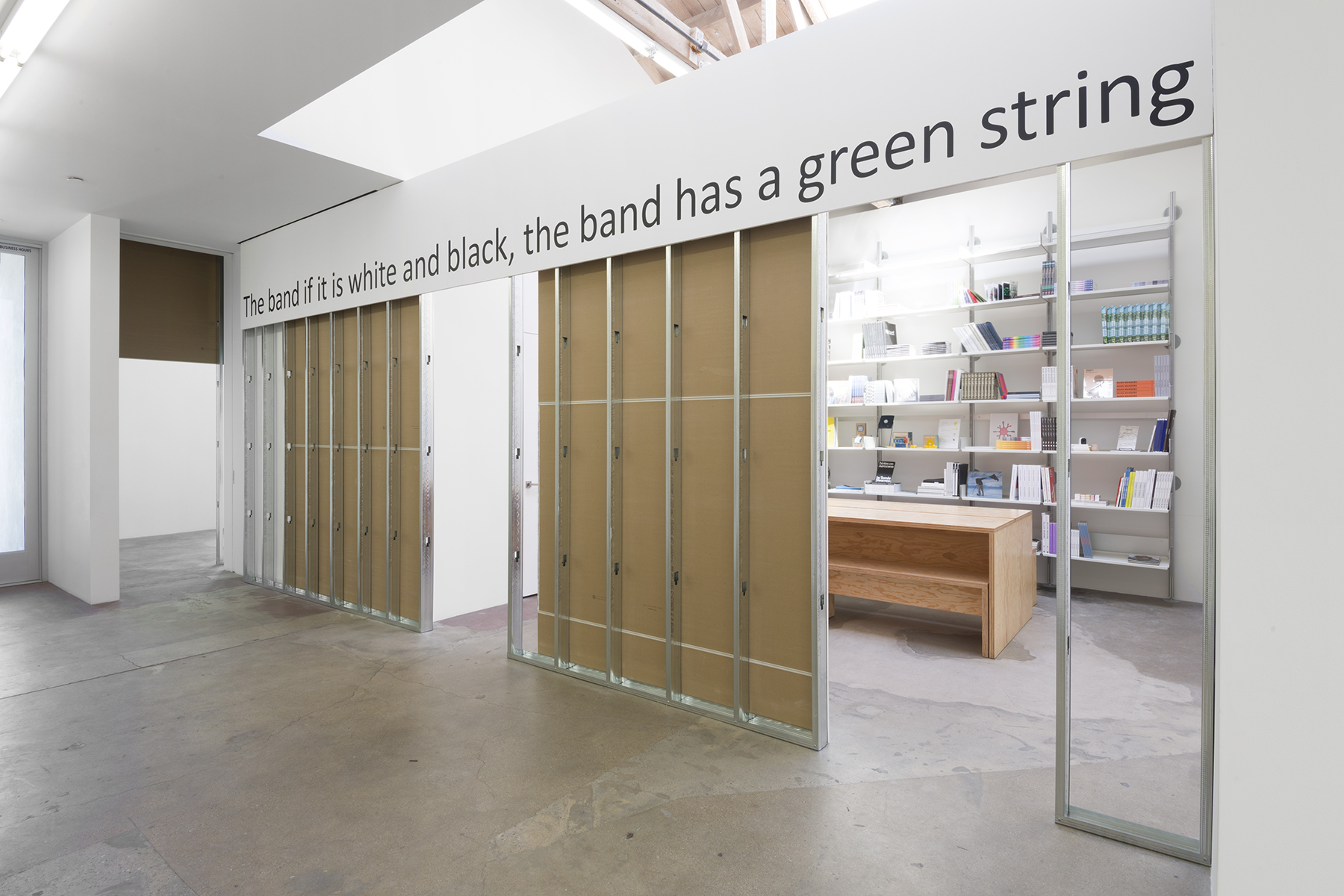 the band if it is white and black the band has a green string,  2019, found text, matte black vinyl, dimensions variable, Edition of 2. Courtesy the artist and Tanya Bonakdar Gallery, New York / Los Angeles