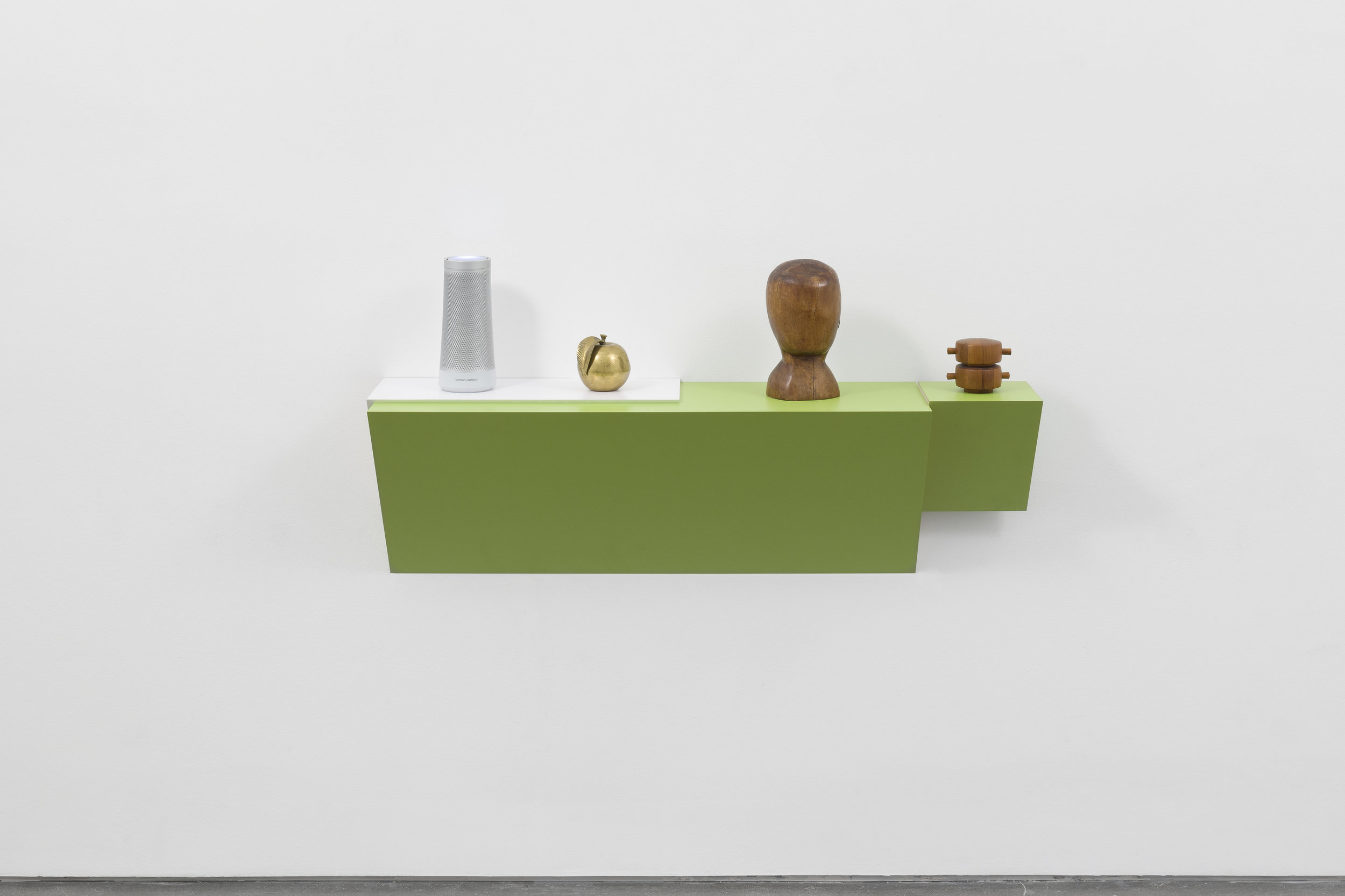 the nutcracker , 2018, lastic laminated wood shelf, electronic smart speaker, brass apple, wooden bust, wood peppermill, 48 ¾ x 45 ½ x 12 ½ in. (123.8 x 115.6 x 31.8 cm). Courtesy the artist and Tanya Bonakdar Gallery, New York / Los Angeles