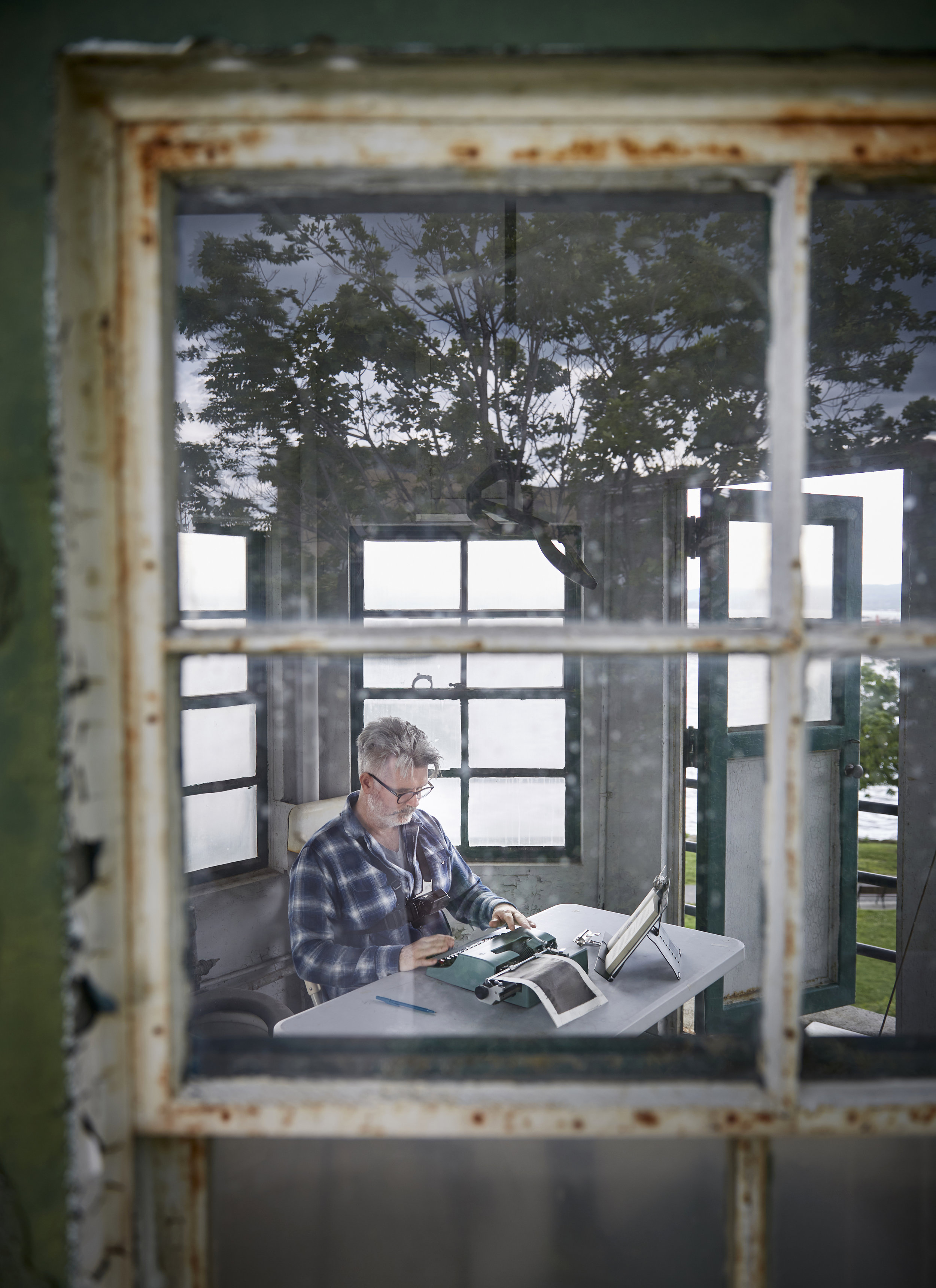 Tim Youd retyping John Cheever's 'Falconer'; 211 pages typed on an Olivetti Lettera 32 (decommissioned guard tower at Sing Sing Prison, Ossining, NY, June 2018). Photo credit: John Muggenborg.