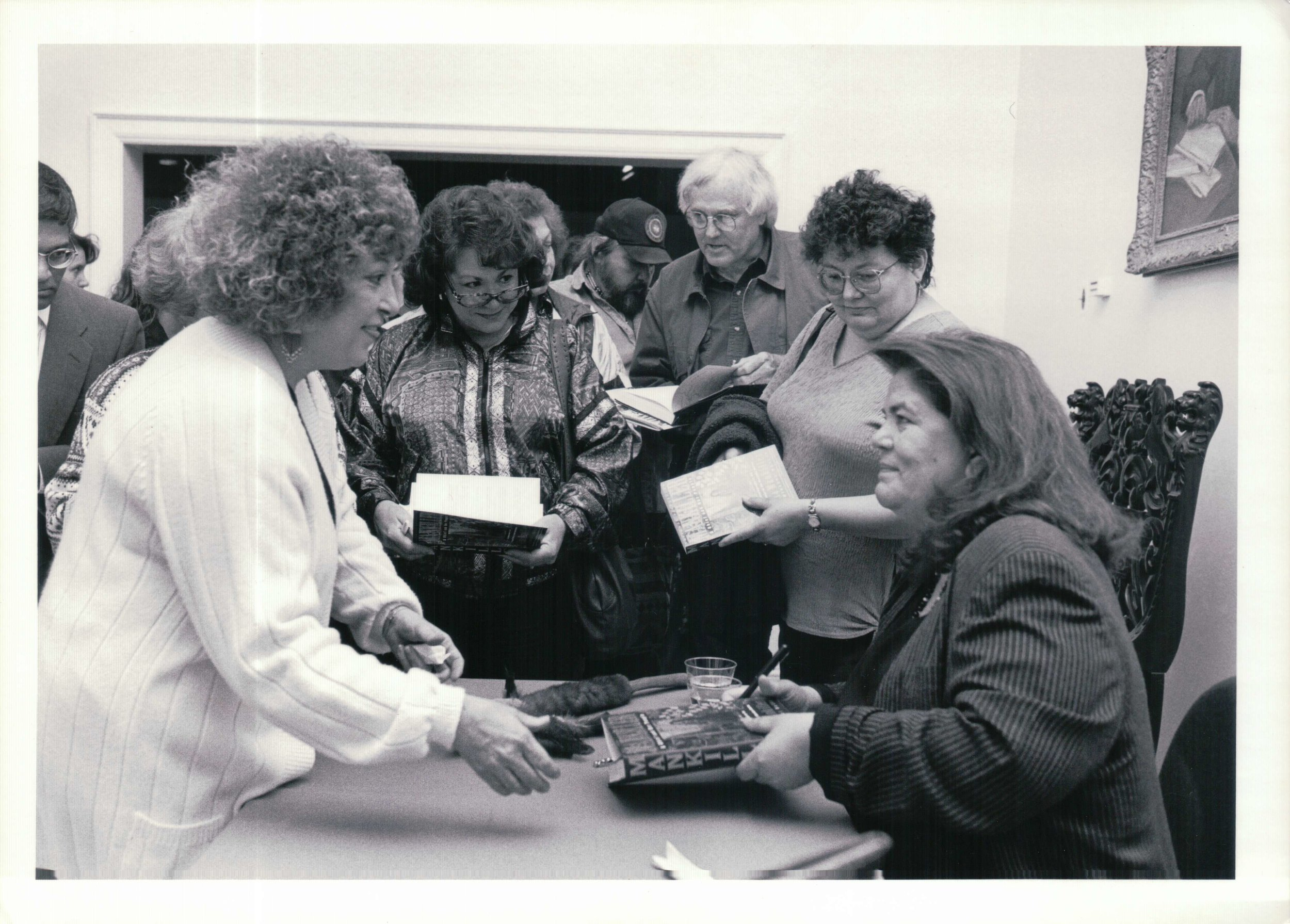 Wilma Mankiller autographs her book