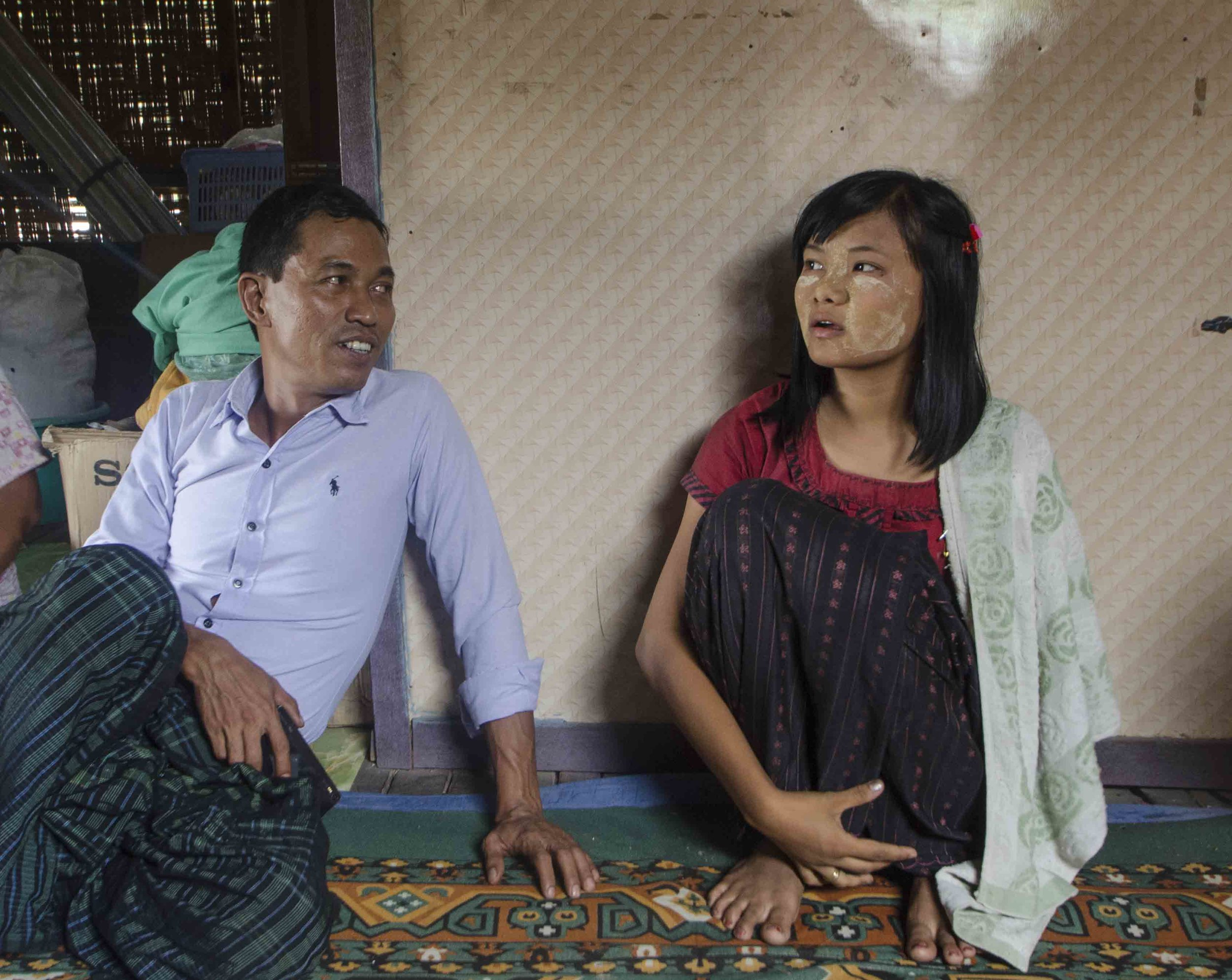 Ko Taw, left, is determined to fight for workers rights in Myanmar. Zin Mar Htwe, right, lost her arm in an hydraulic press while working at a steel factory [Charles Michio Turner/Al Jazeera]