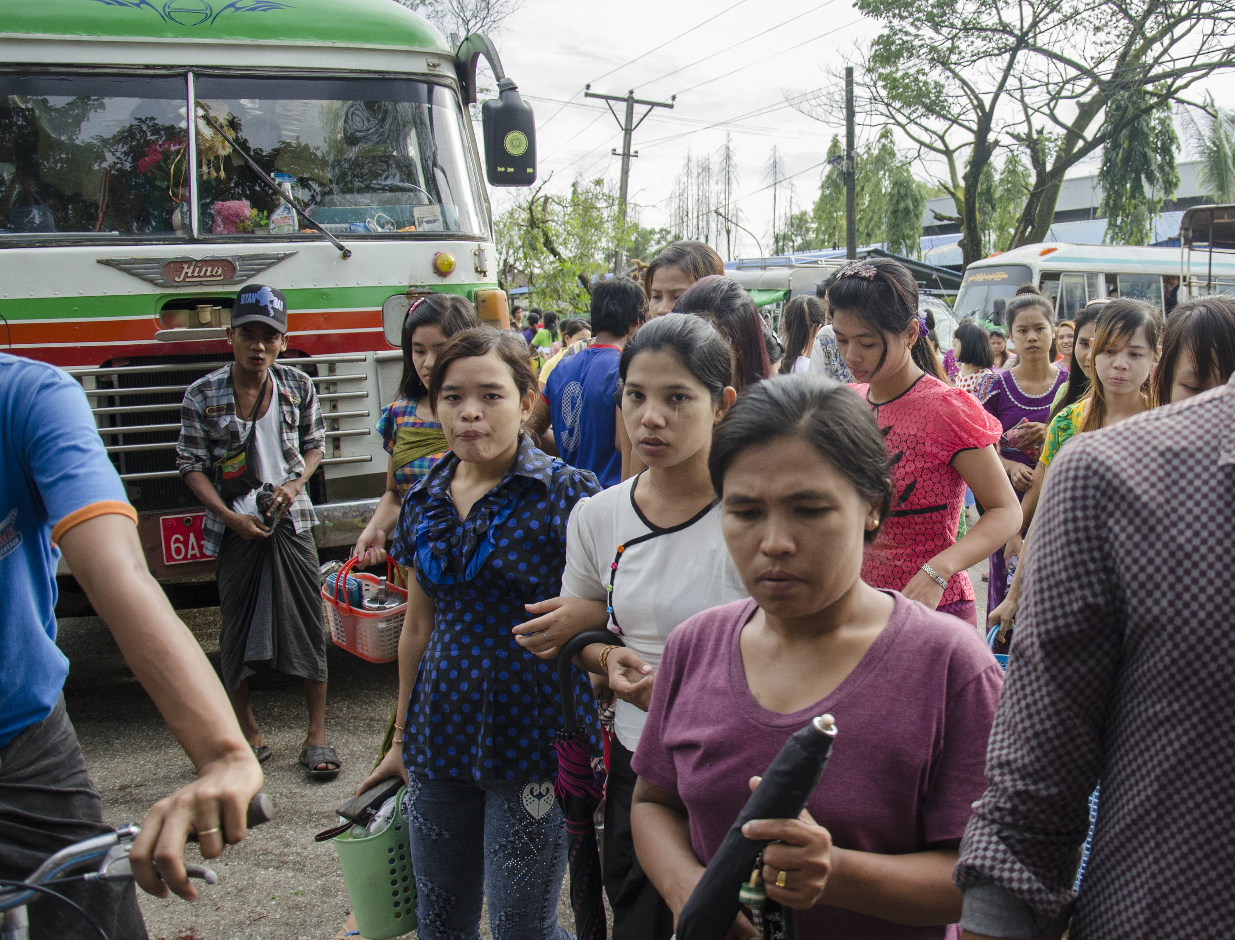(YANGON) Outside an overtime shift at the York Garment Factory in Hlaing Thar Yar Township. With over 20,000 workers, York Garment manufacturers products for H&M and other international retailers. [Charles Michio Turner/Frontier]