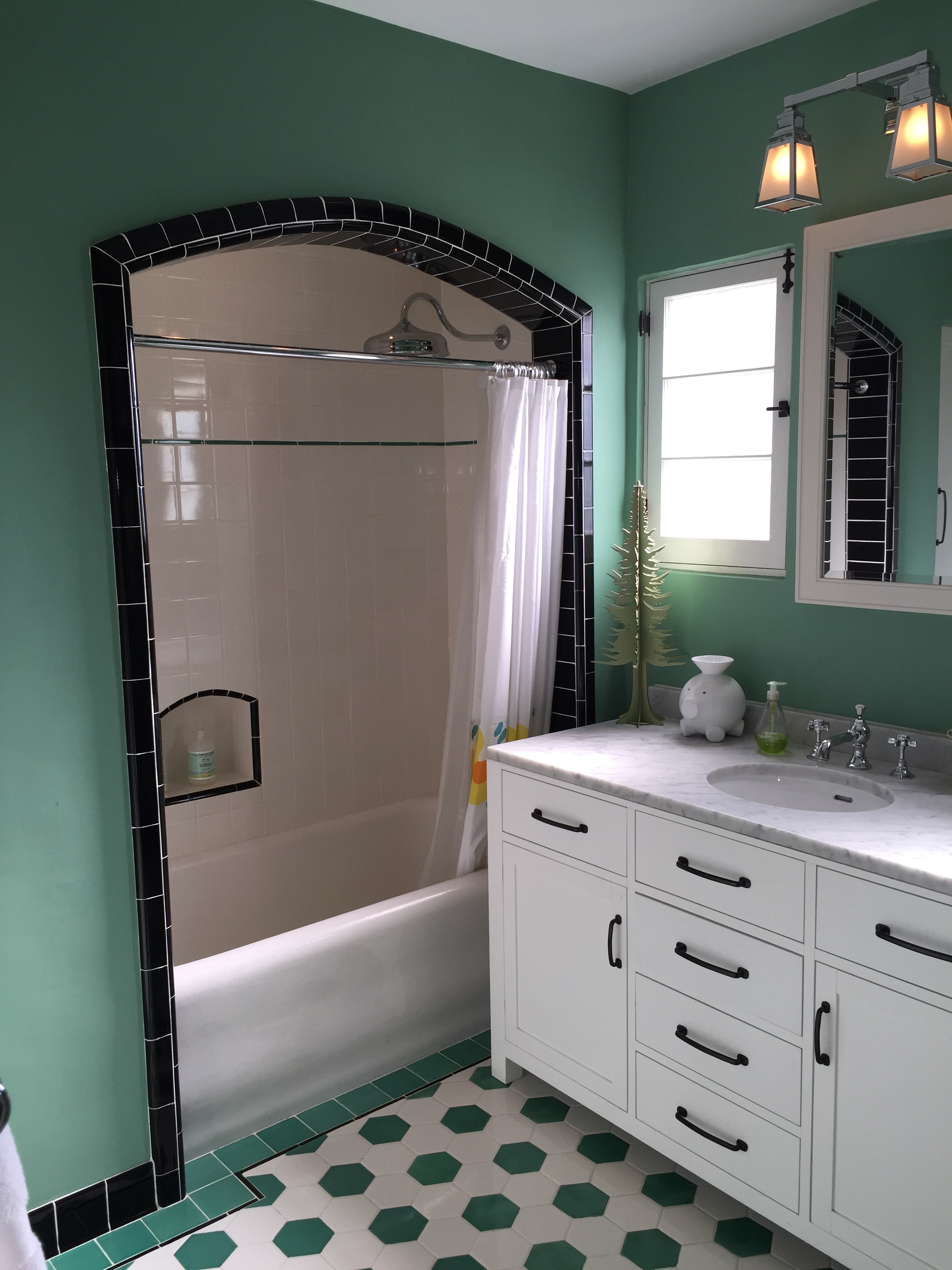 1927 bathroom re-created to replace a dated 60's remodel.  Modern features, 1920's looks.