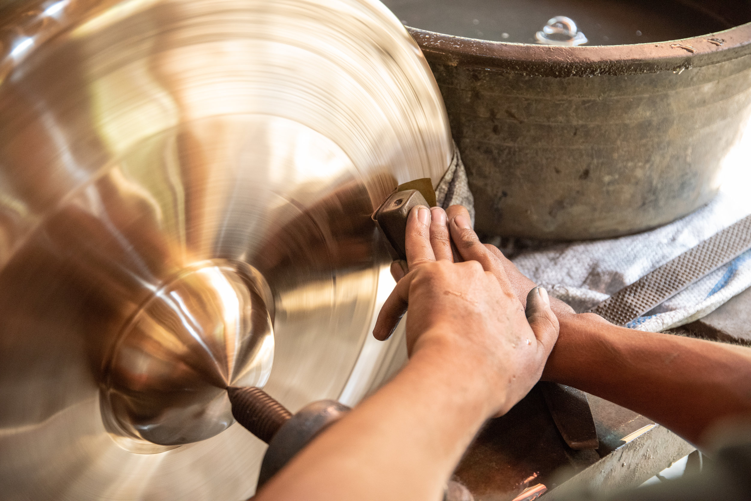 Large gamelan gong is carefully polished