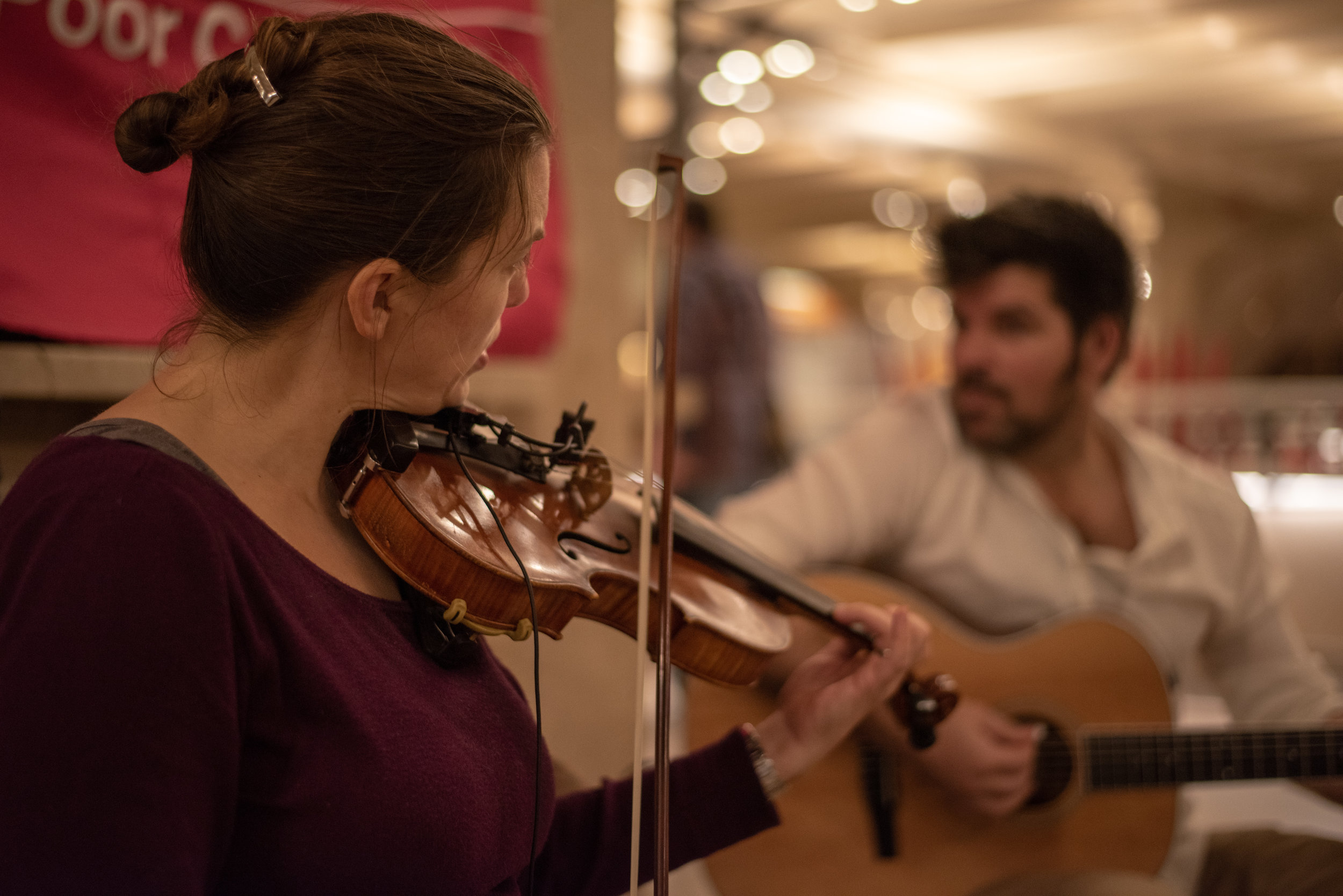 Wife Naomi, from Vermont, plays her fiddle.