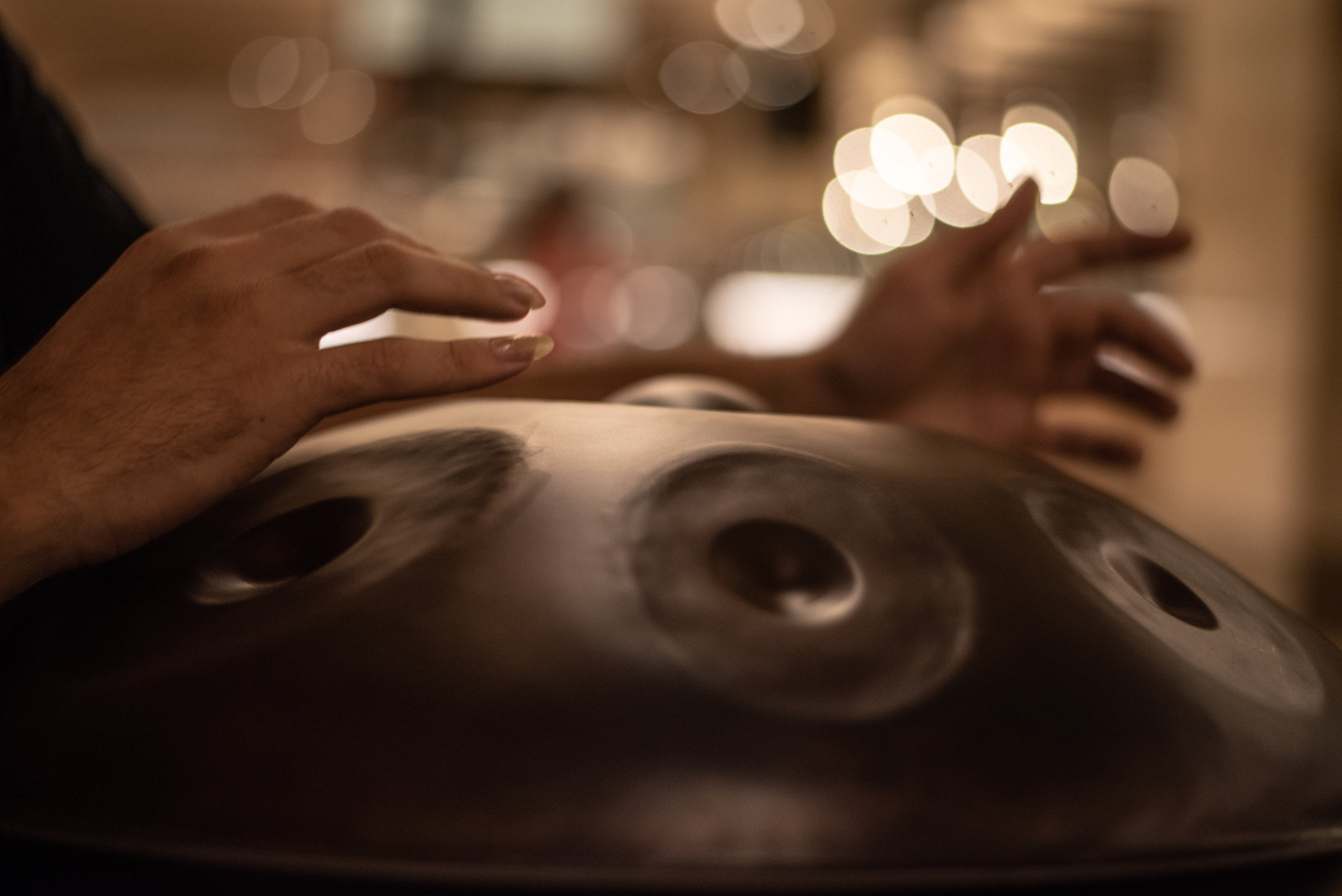 The Hang, a class of steel drum known as a hand pan, is played by gently striking the grooved areas with fingers. Each section is precisely tuned to produce a specific note.