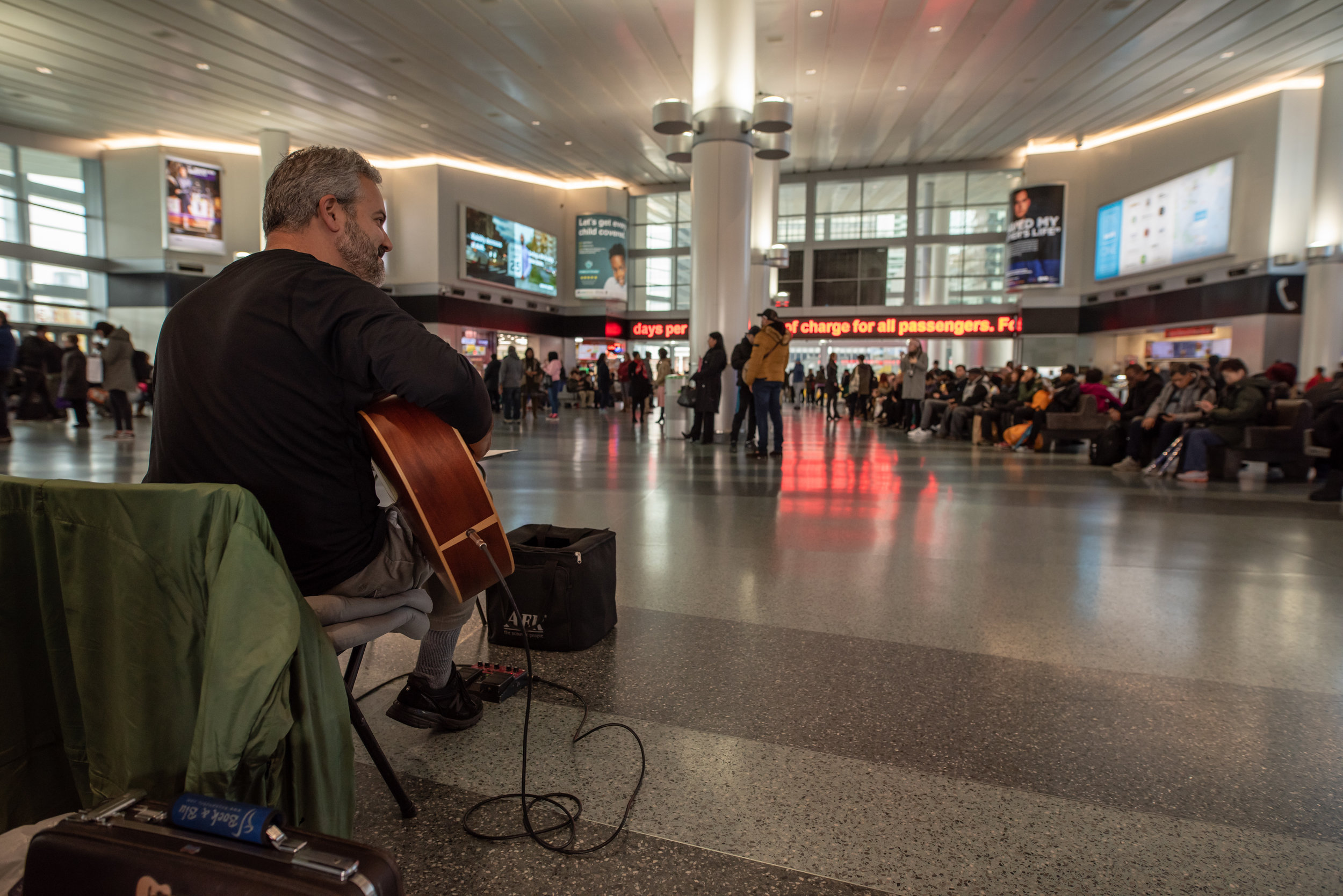 Glenn performs at Whitehall terminal for the Staten Island Ferry.