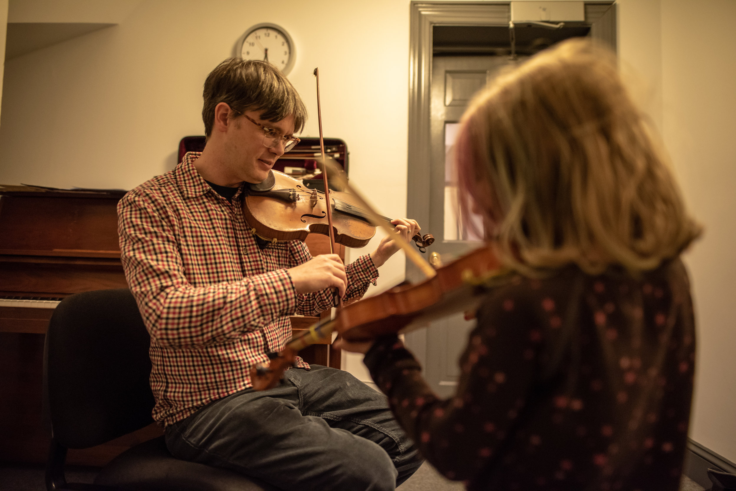 Here Tom provides violin lessons to students of all ages.