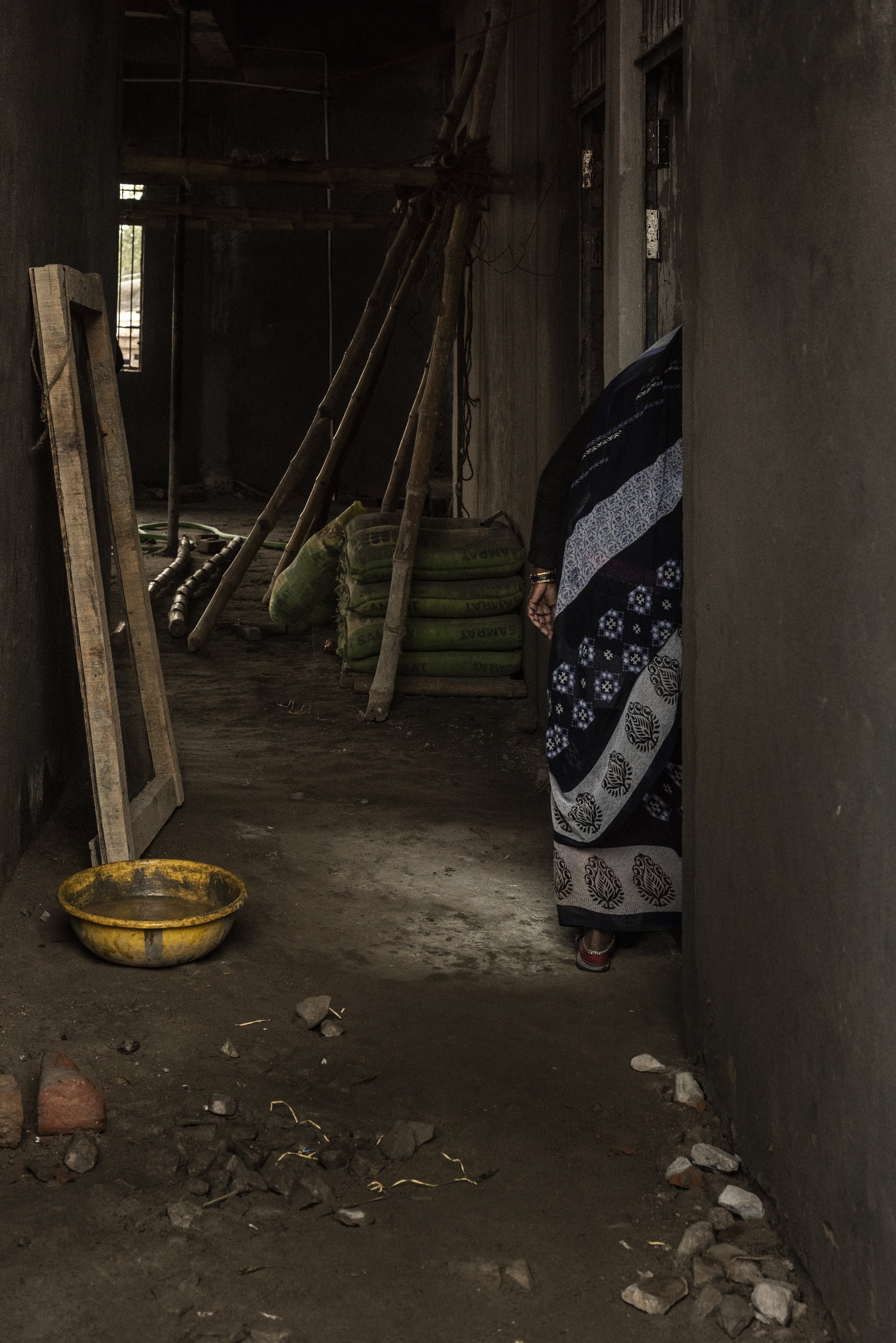 Woman dwelling in an abandoned building