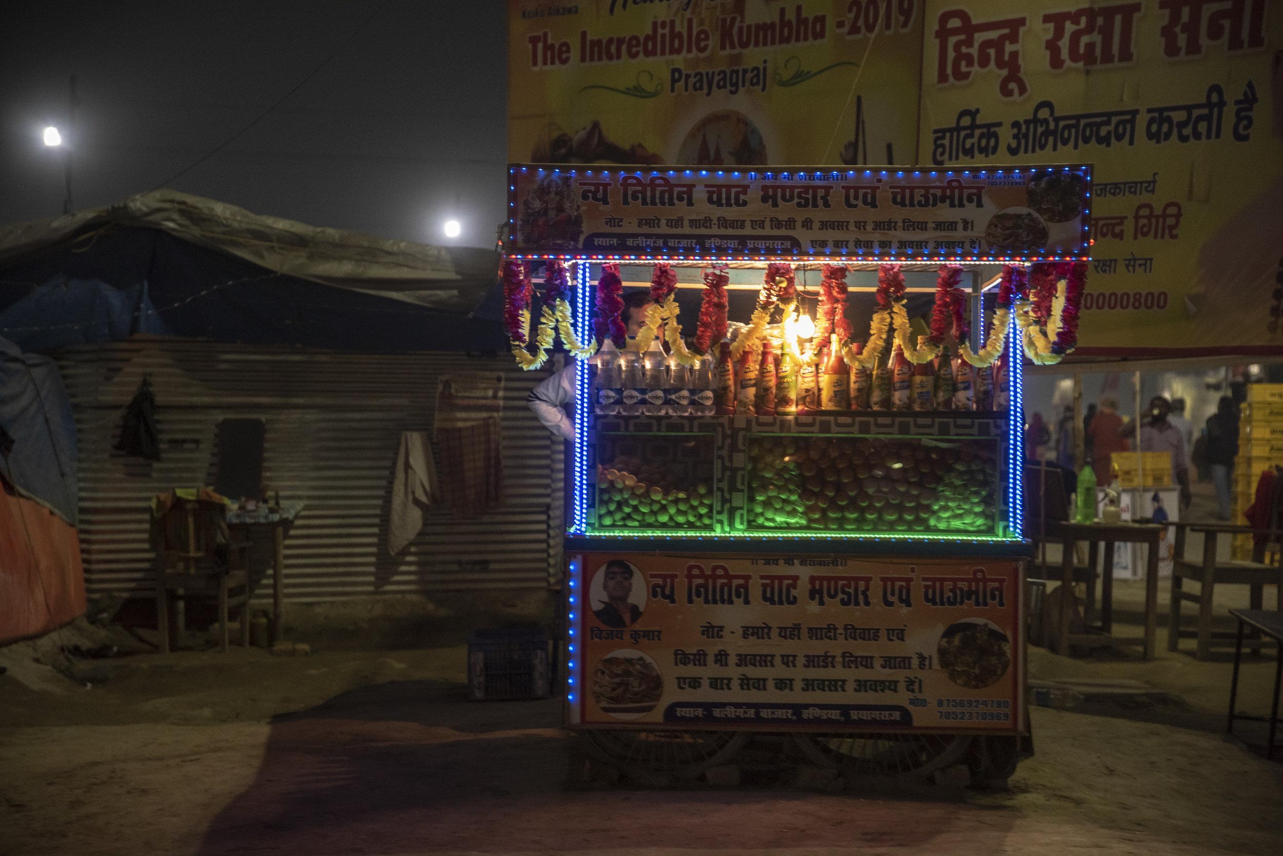 Illuminated roadside food stall