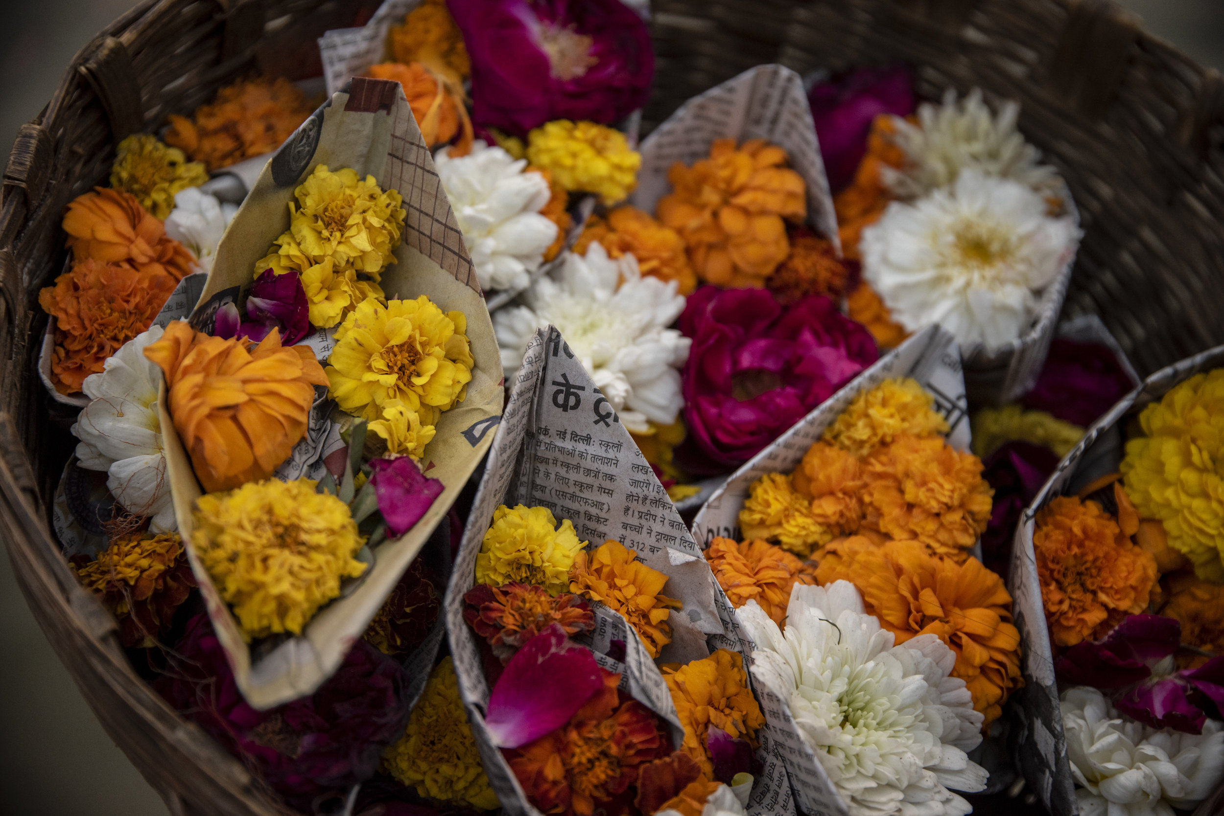 Flowers are sold along the shoreline as puja offerings to the Gods.