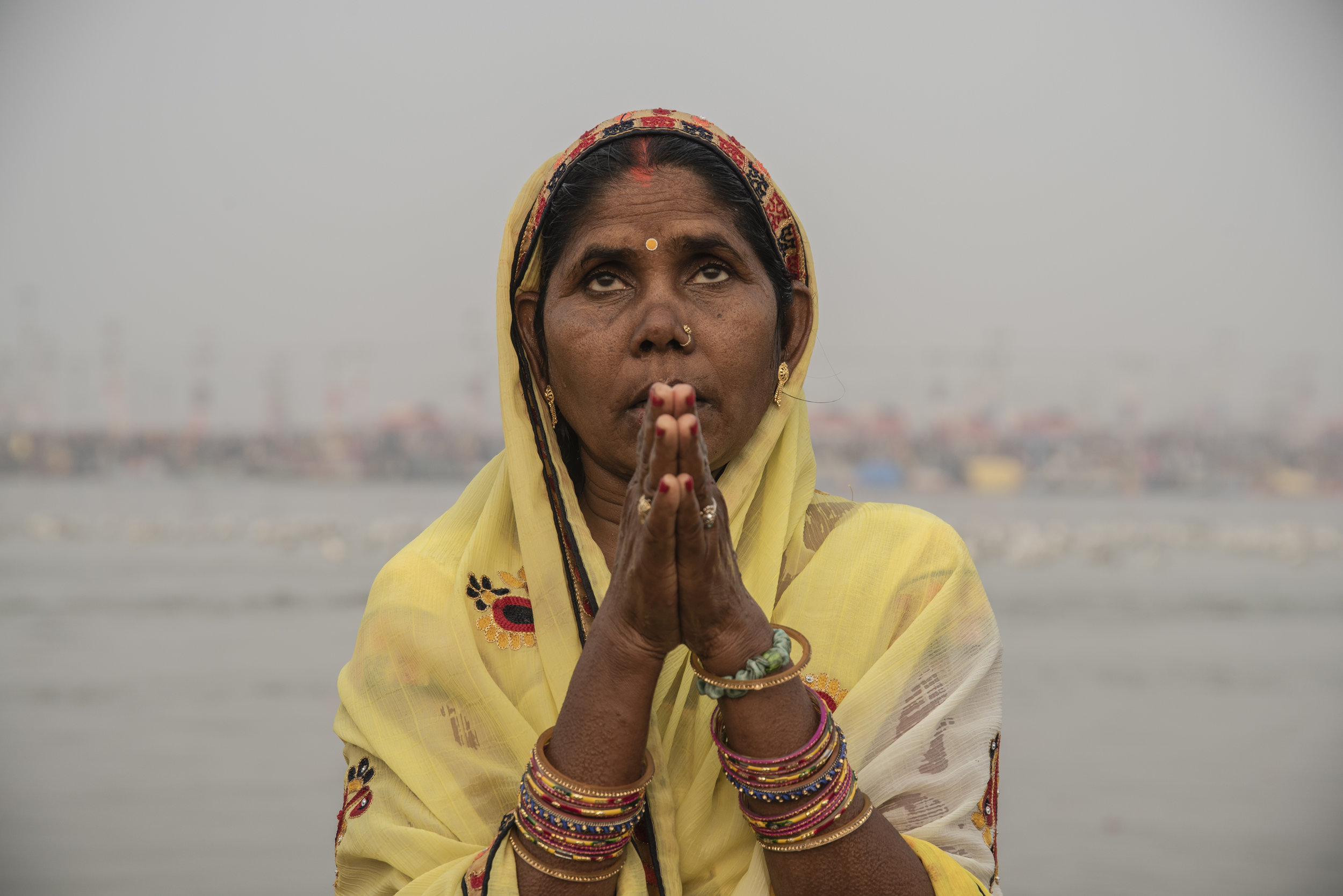 Woman prays in the Ganges