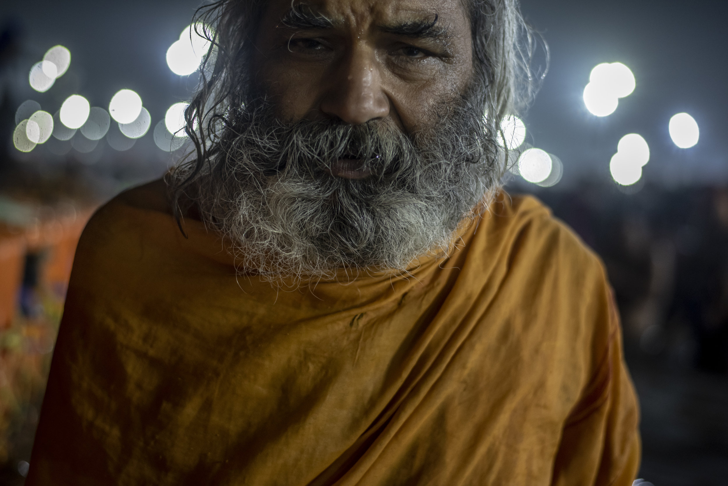 Sadhu stands stoically in the cold waters of the Ganges for almost an hour