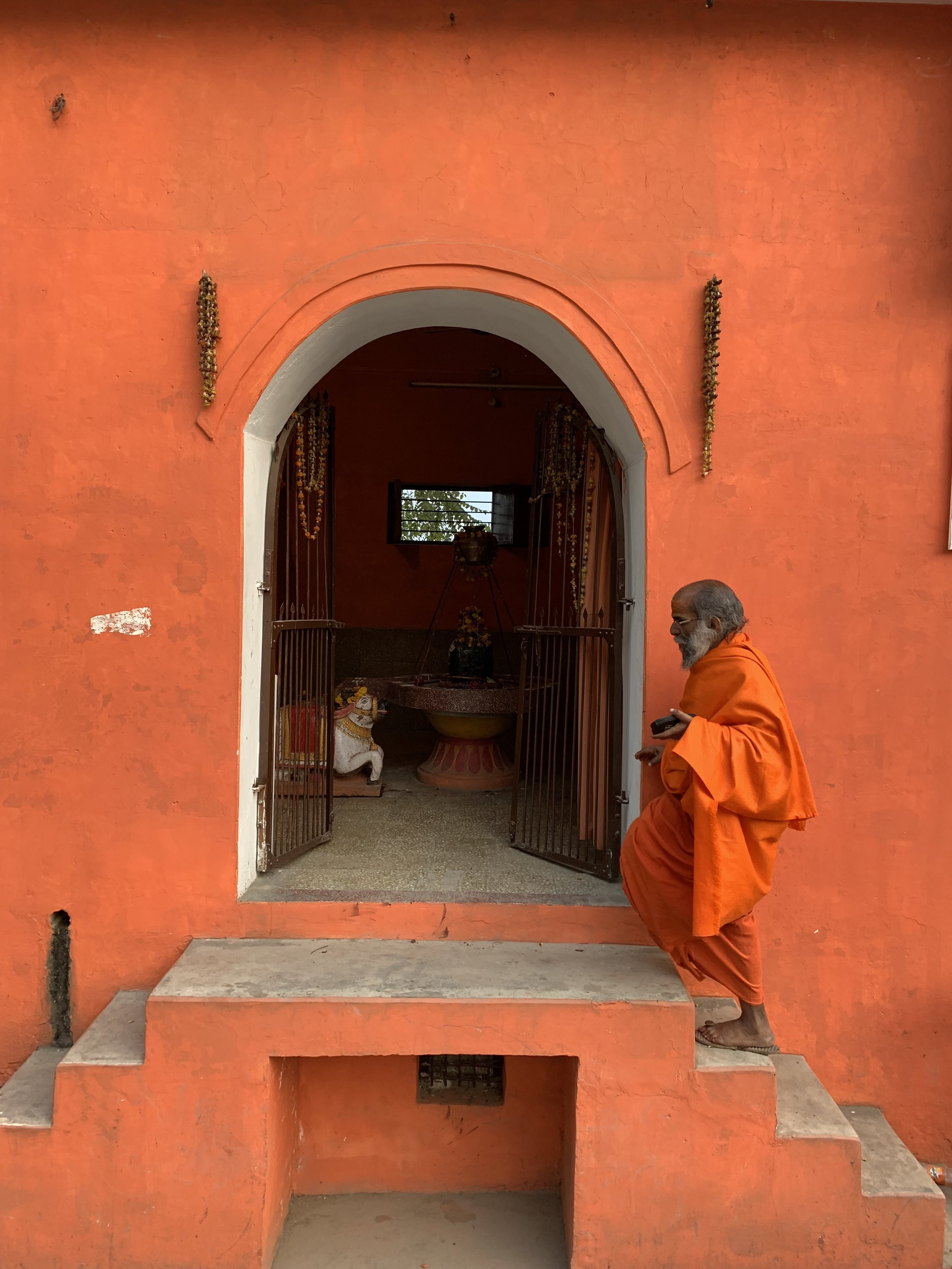 Guru enters a Hindu temple that he upkeeps.