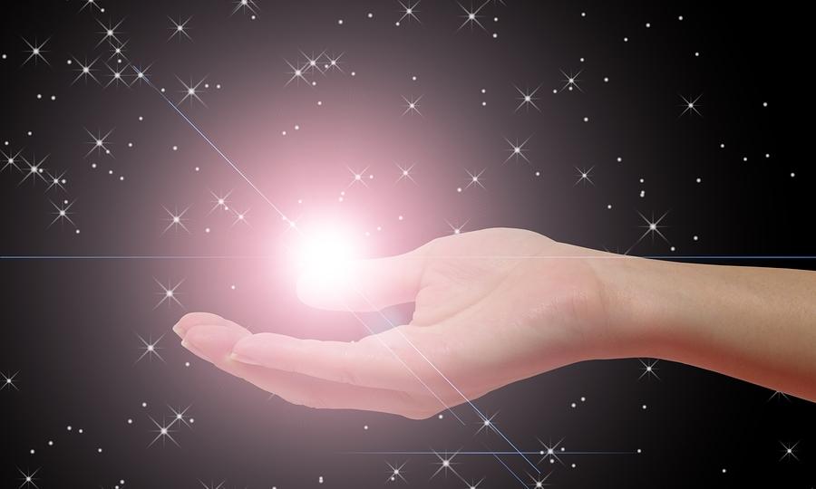 psychic bigstockphoto_Hand_Holding_Star_273160
