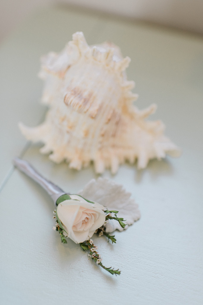 Brian's bout was light and simple, with a single spray rose and waxflower tucked into a leaf of dusty miller.
