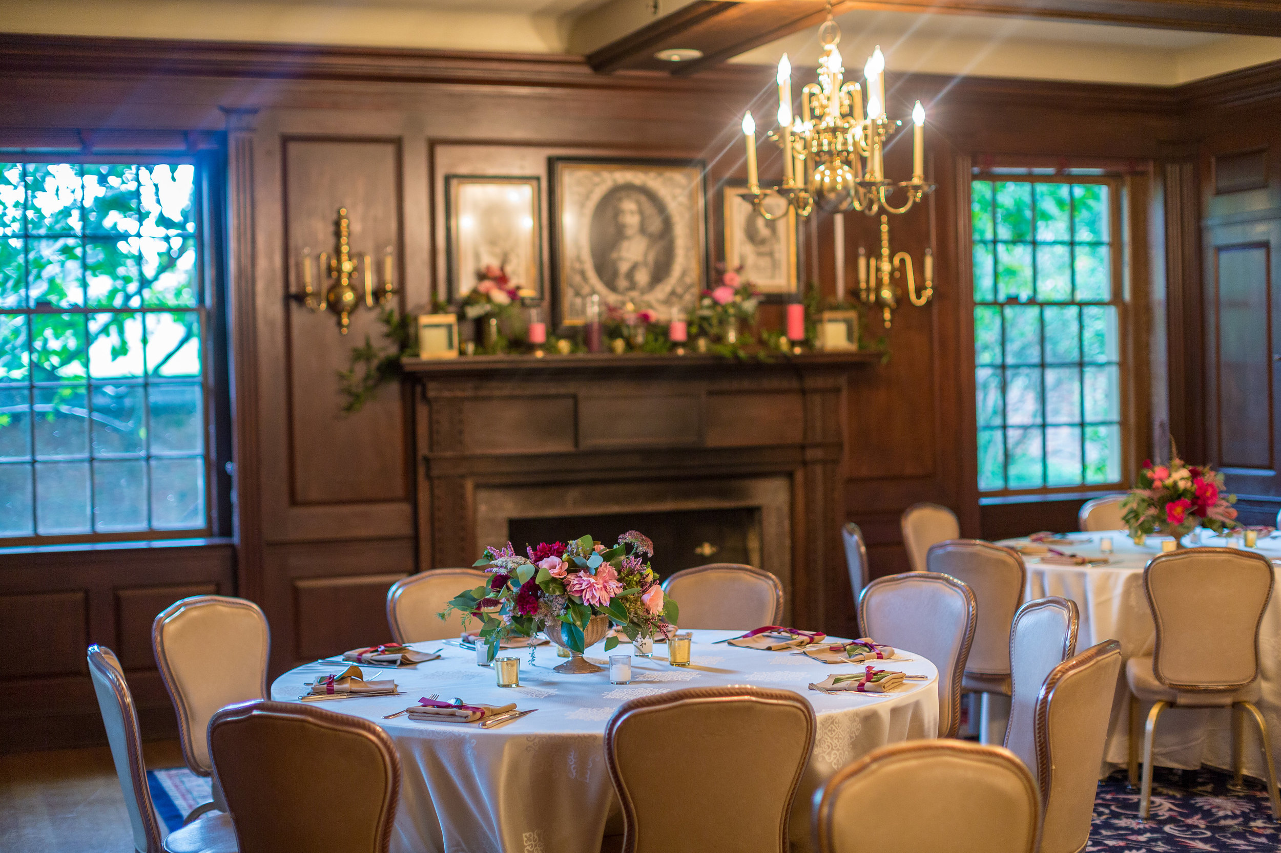 "I had an open seating plan to encourage guests to mingle and wander throughout the rooms of Brantwyn.  Each room had different color schemes and incredibly ornate mantle pieces.  I told them ""not to worry about it,"" but should have known that Mary and Dawn would never leave them untouched!"