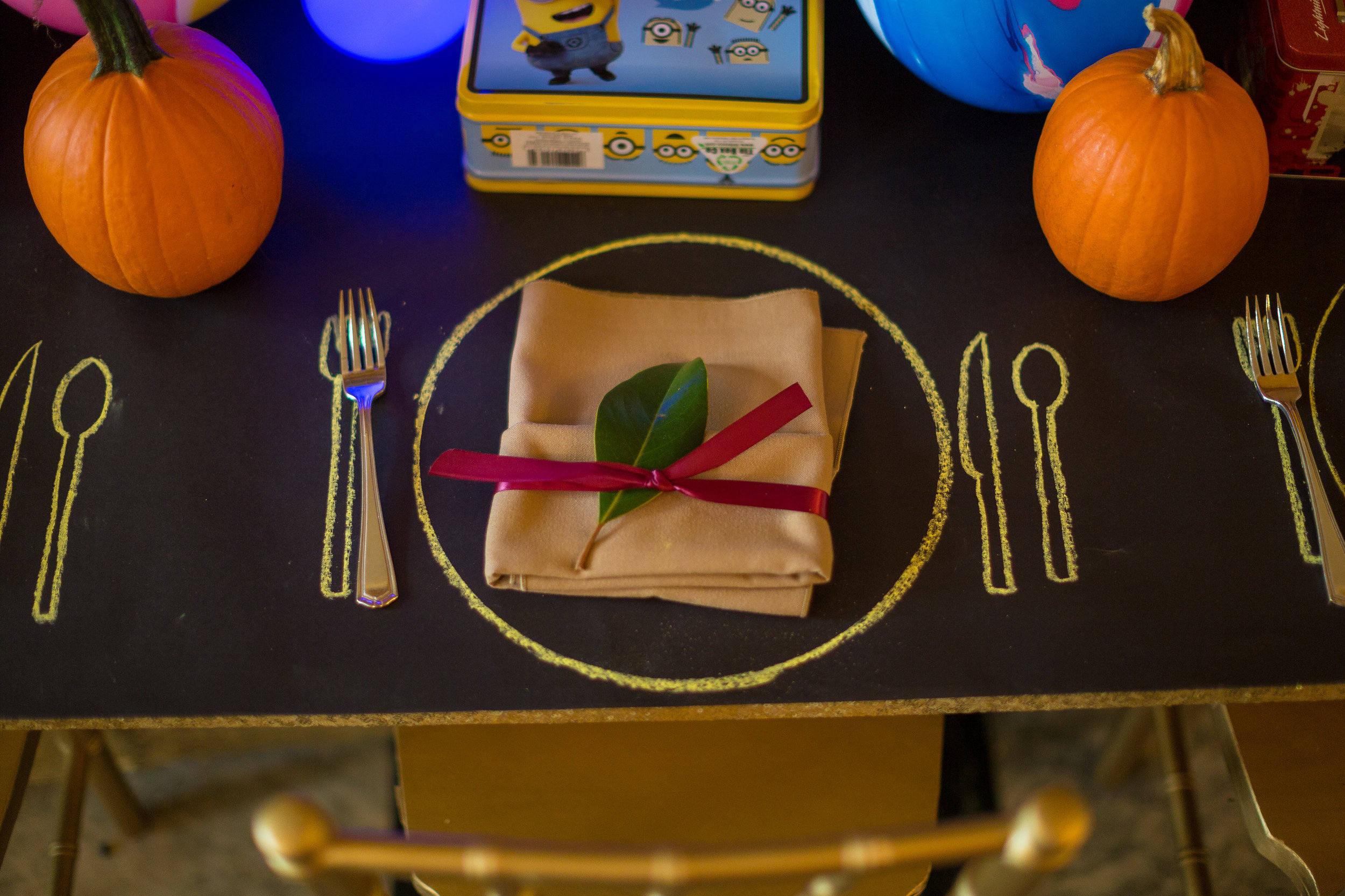 Kevin and I have a son together, and our niece and nephews are incredibly close to us.  What better way to celebrate with the kids than to put together a vibrant children's section??  Leave it to Dawn to find a miniature table with miniature GOLD CHIVARI CHAIRS.
