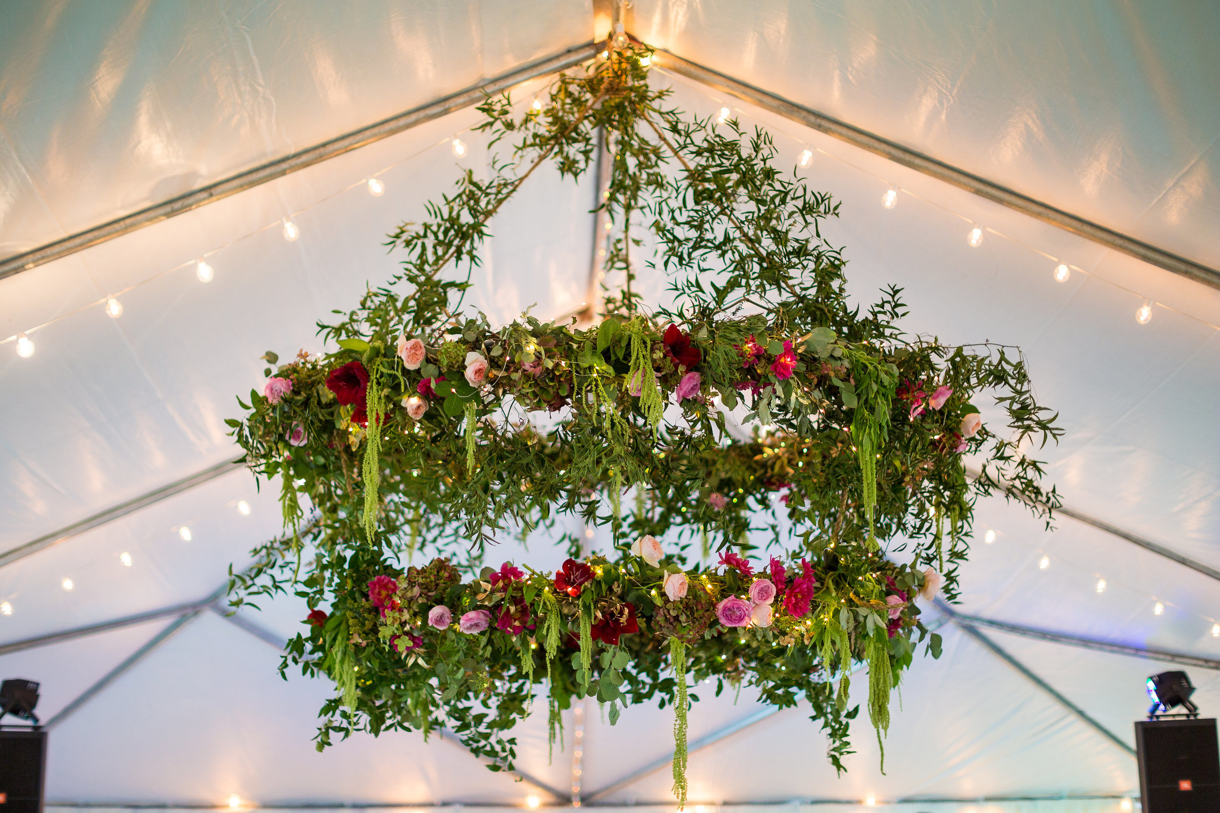 I like to think that I was the show-stopper on my wedding night, but clearly it was this magestic piece of floral goodness.  This two-tiered chandelier stopped everyone in their tracks.  Rigged with strands of fairy lights, layers of smilax, dozens of roses, it was a stunning piece of art.  The hanging green amaranthus was my favorite part.