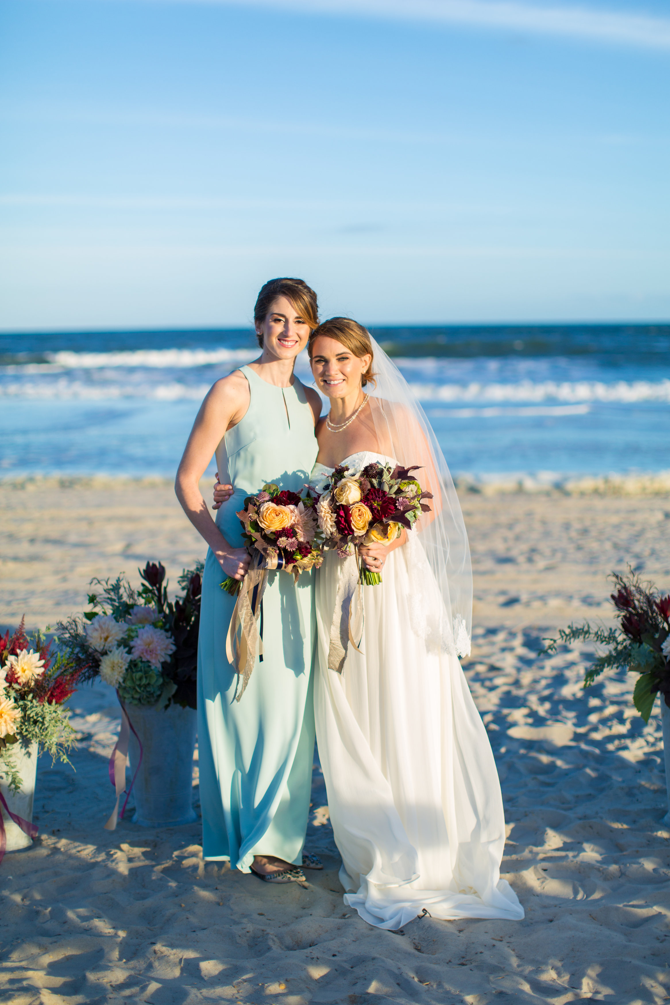Jenna's bridesmaid carried a similar bouquet to her own, which contrasted perfectly with the light teal shade of her dress.