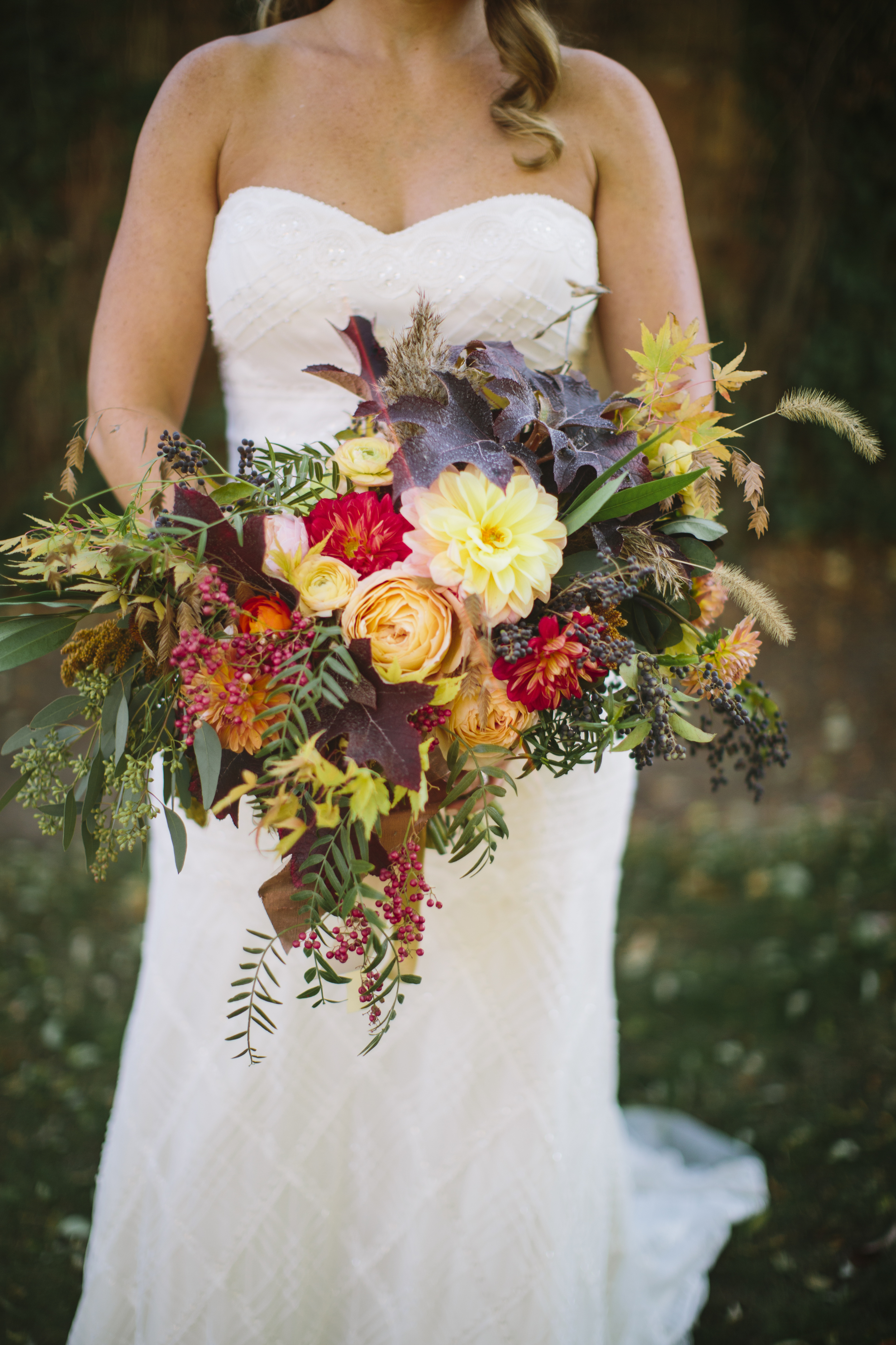 Emily's bridal bouquet was dramatic, wild, and lush. Dahlias, roses, leaves, eucalyptus, berries, ranunculus and various elements of greenery came together in this amazing combination to create one of our most memorable bouquets to date.