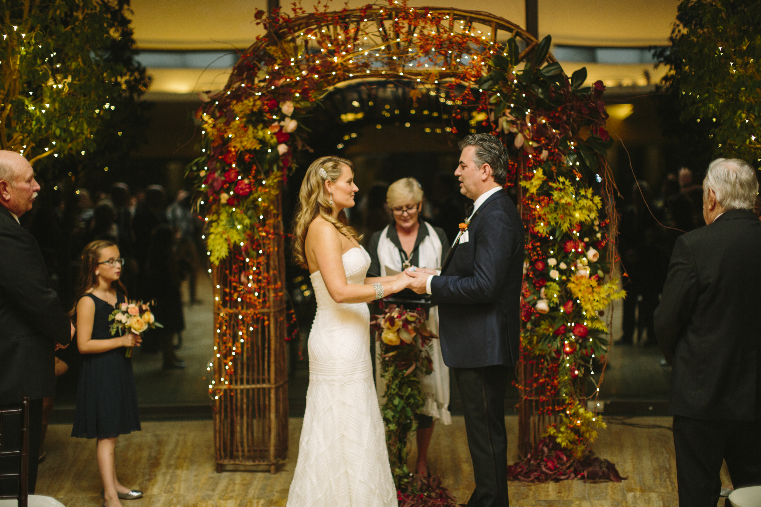 An evening ceremony darkened the backdrop, letting the arch and fairy lights really pop as they framed the couple.